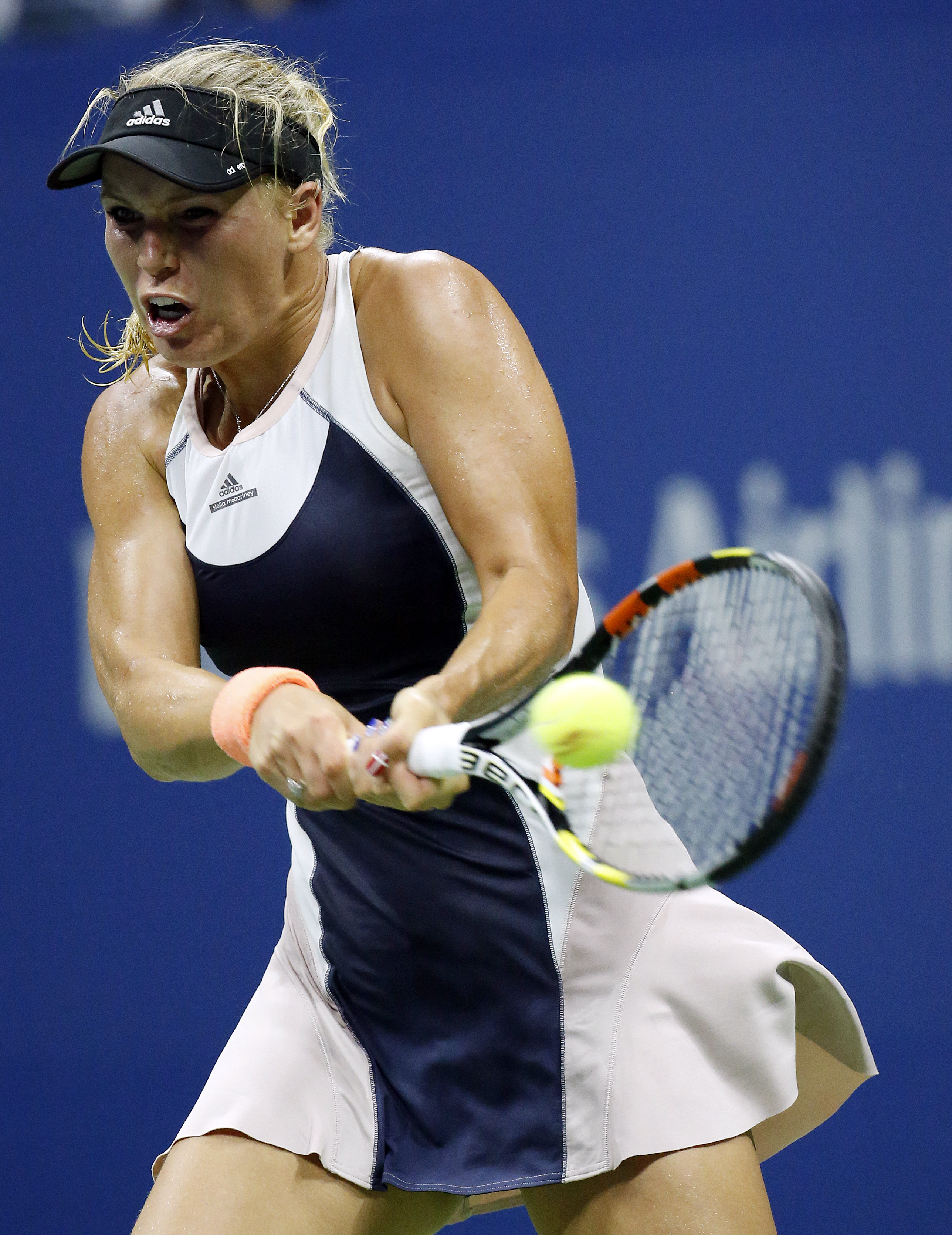 Caroline Wozniacki, of Denmark, returns a shot to Petra Cetkovska, of the Czech Republic, during the second round of the U.S. Open tennis tournament in New York, Thursday, Sept. 3, 2015. (AP Photo/Julio Cortez)