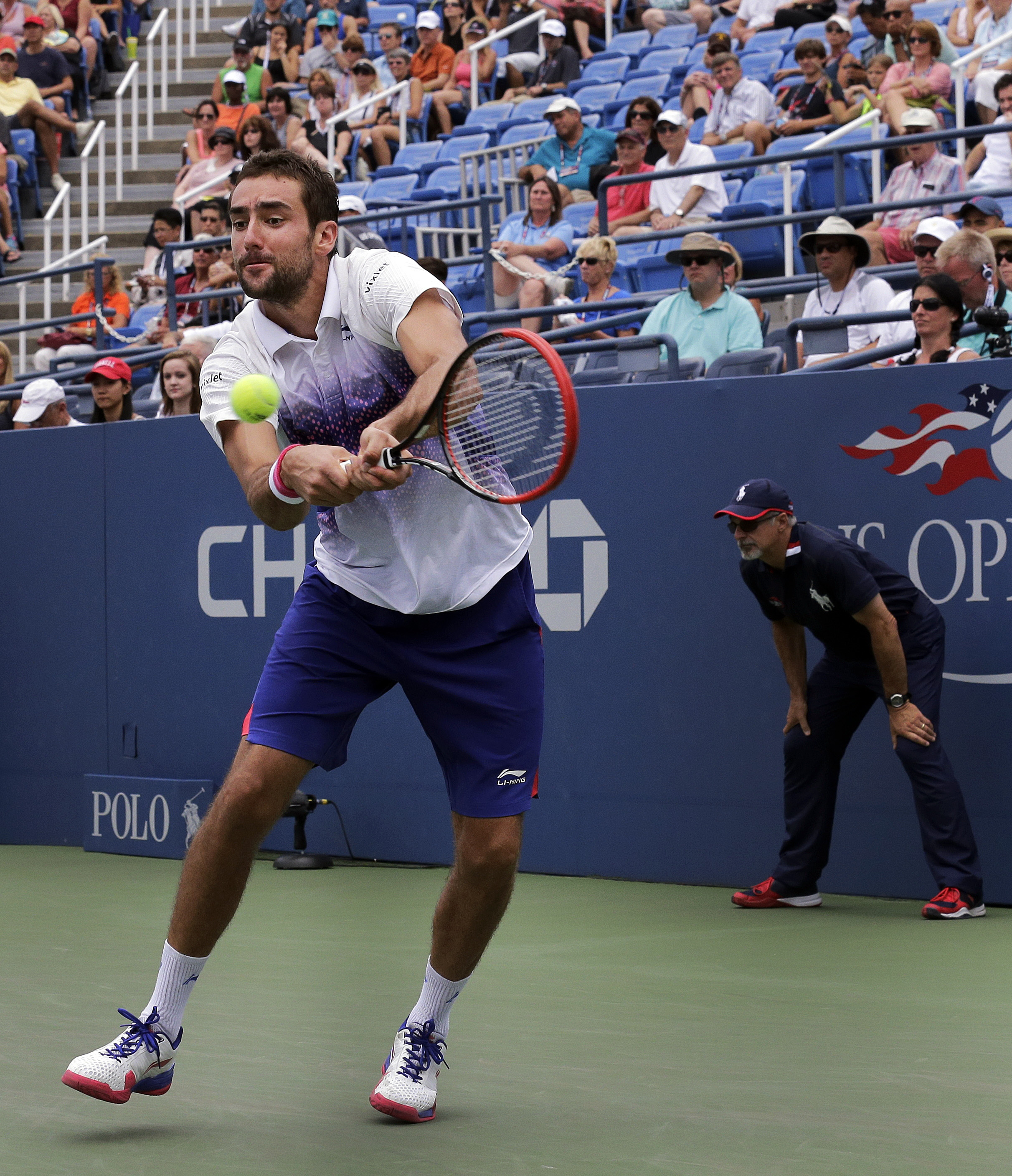Marin Cilic, of Croatia, returns a shot to Mikhail Kukushkin, of Kazakhstan, during the third round of the U.S. Open tennis tournament, Friday, Sept. 4, 2015, in New York. (AP Photo/Charles Krupa)