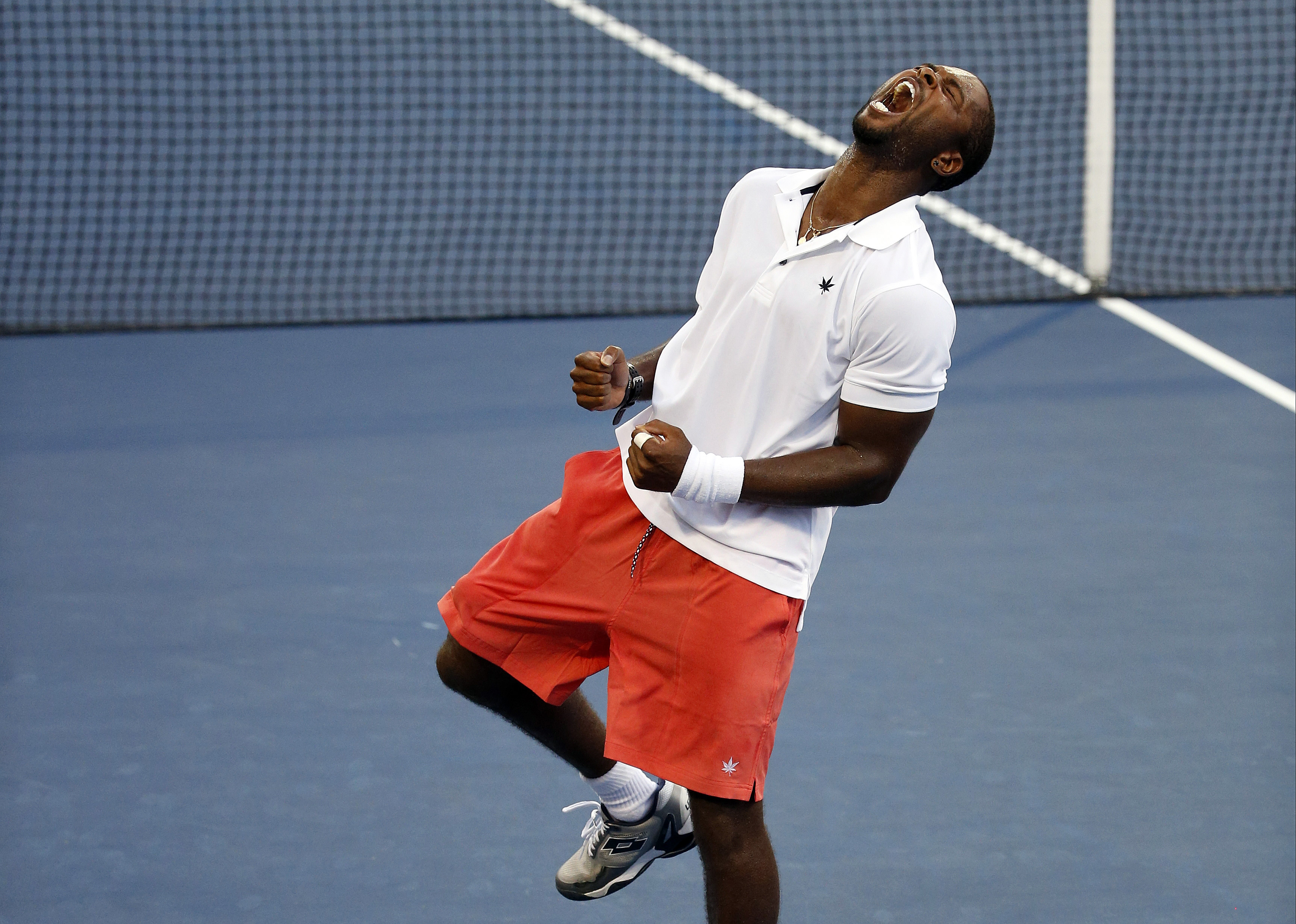 Donald Young, of the United States, celebrates after beating Viktor Troicki, of Serbia, during the third round of the U.S. Open tennis tournament, Saturday, Sept. 5, 2015, in New York. (AP Photo/Julio Cortez)