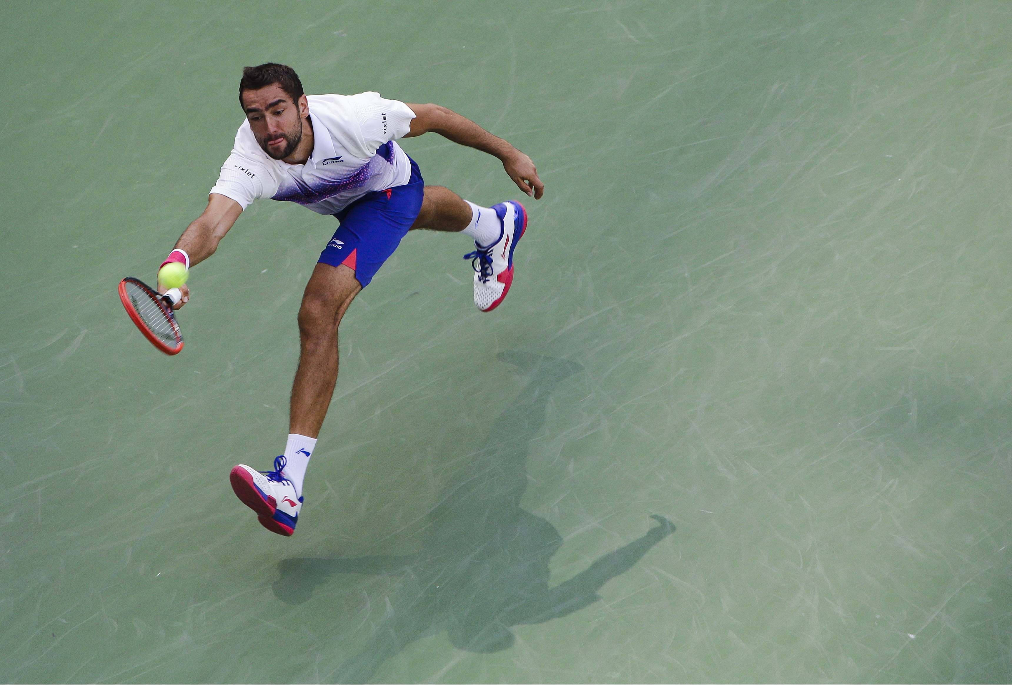 Marin Cilic, of Croatia, reaches a shot by Jeremy Chardy, of France, during the fourth round of the U.S. Open tennis tournament, Sunday, Sept. 6, 2015, in New York. (AP Photo/Matt Rourke)