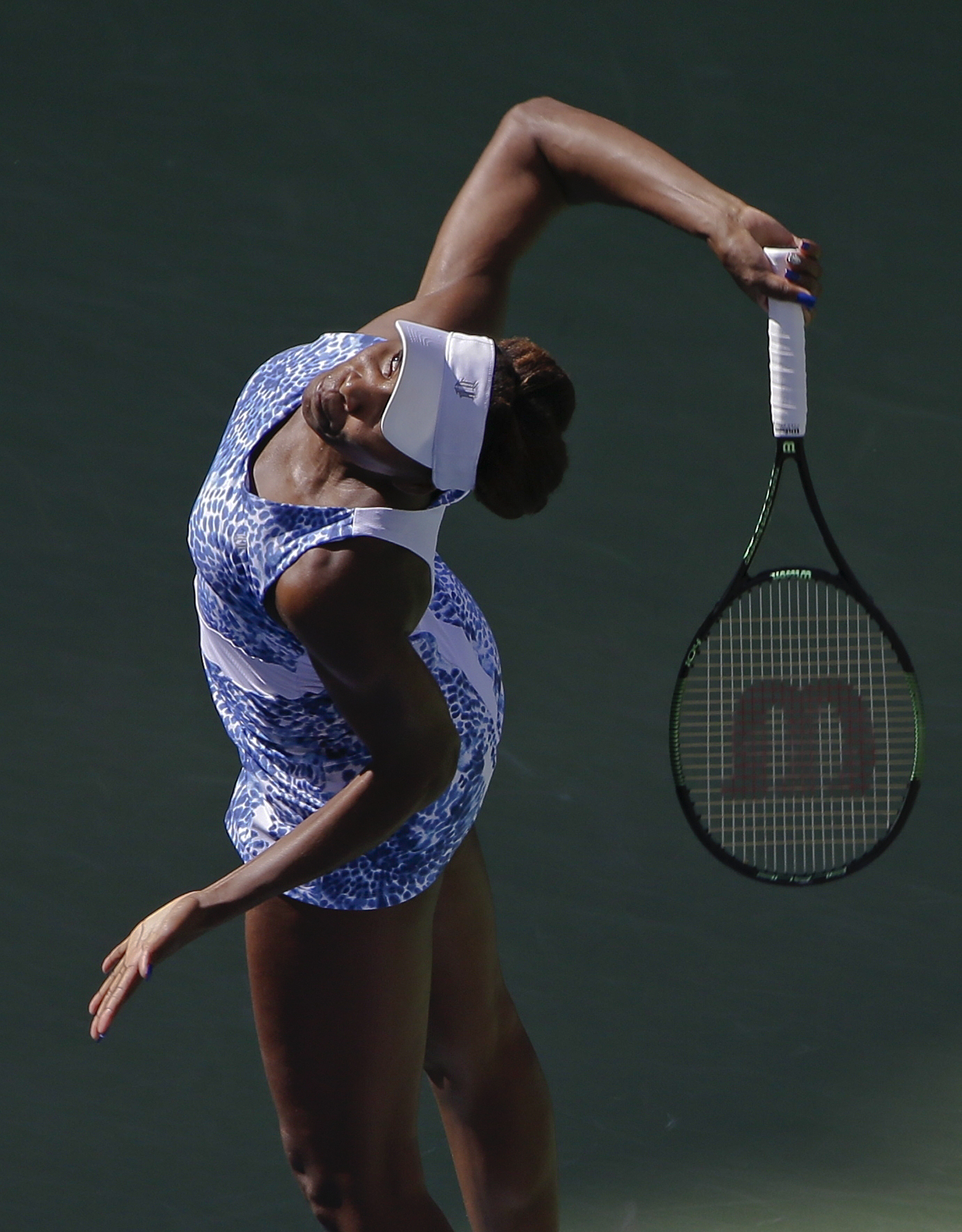 Venus Williams, of the United States, serves to Anett Kontaveit, of Estonia, during the fourth round of the U.S. Open tennis tournament, Sunday, Sept. 6, 2015, in New York. (AP Photo/Matt Rourke)