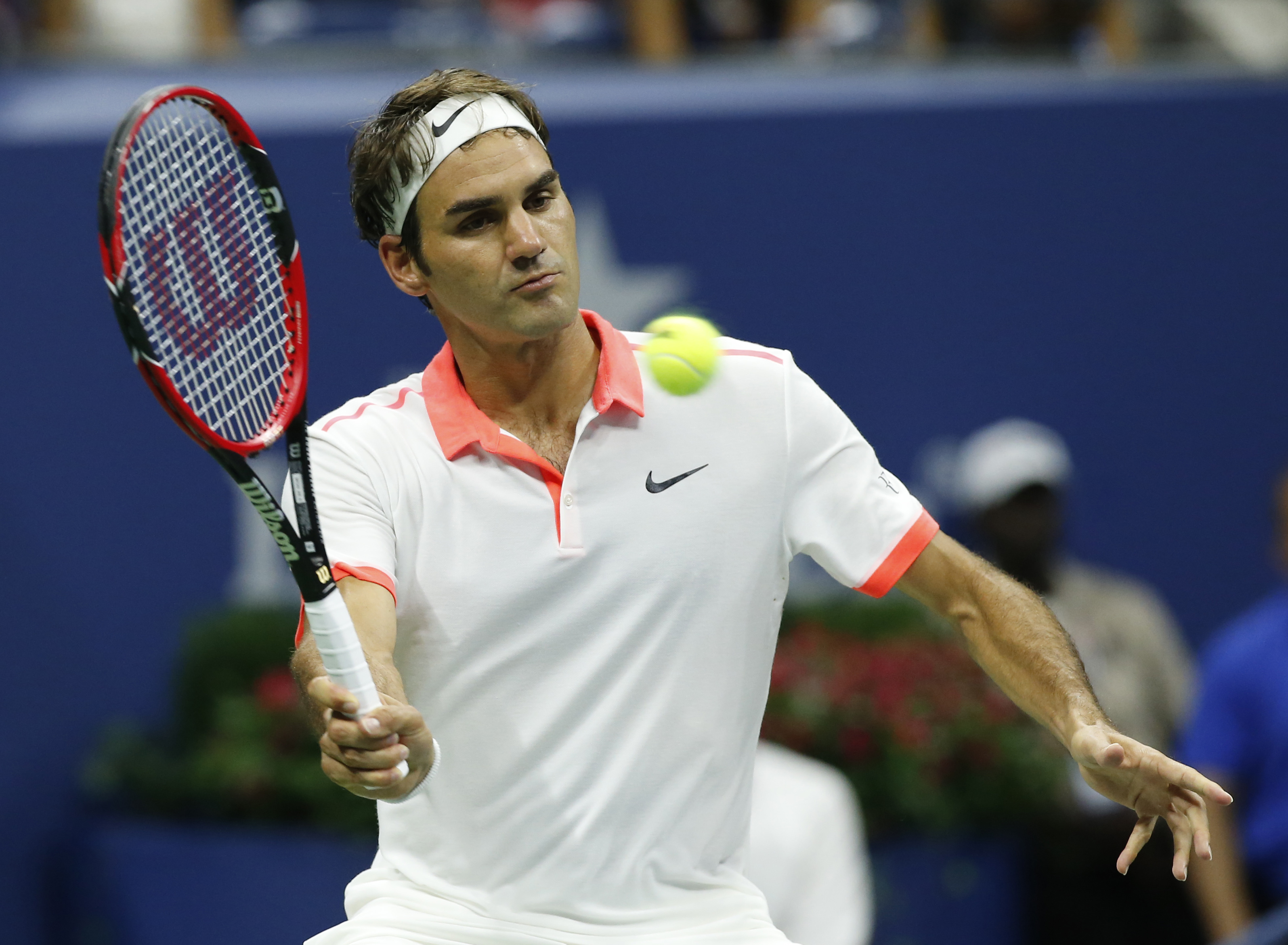 Roger Federer, of Switzerland, returns the ball during his fourth round match against John Isner at the U.S. Open tennis tournament in New York, Monday, Sept. 7, 2015.  (AP Photo/Kathy Willens)