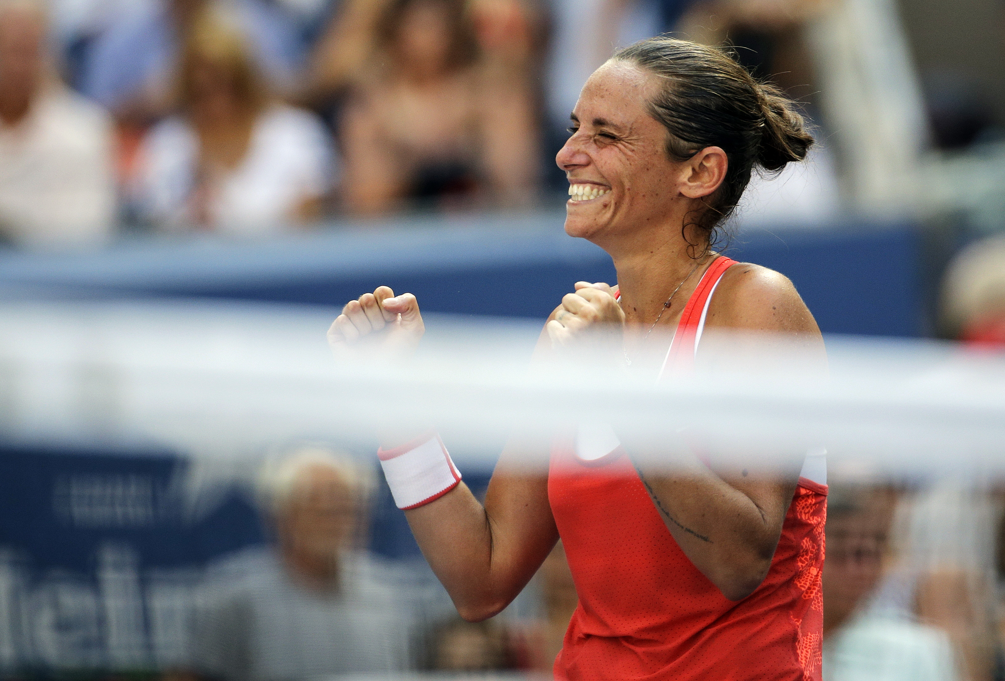 Roberta Vinci, of Italy, reacts after defeating Kristina Mladenovic, of France, during a quarterfinal match at the U.S. Open tennis tournament, Tuesday, Sept. 8, 2015, in New York. (AP Photo/David Goldman)