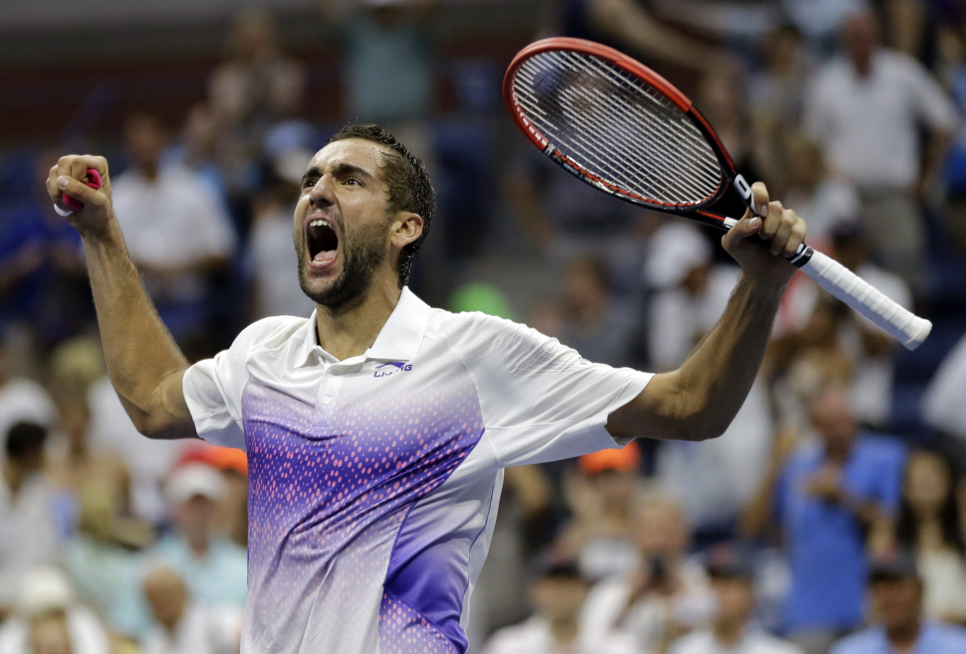 Marin Cilic, of Croatia, reacts after beating Jo-Wilfried Tsonga, of France, during a quarterfinal match at the U.S. Open tennis tournament, Tuesday, Sept. 8, 2015, in New York. (AP Photo/David Goldman)