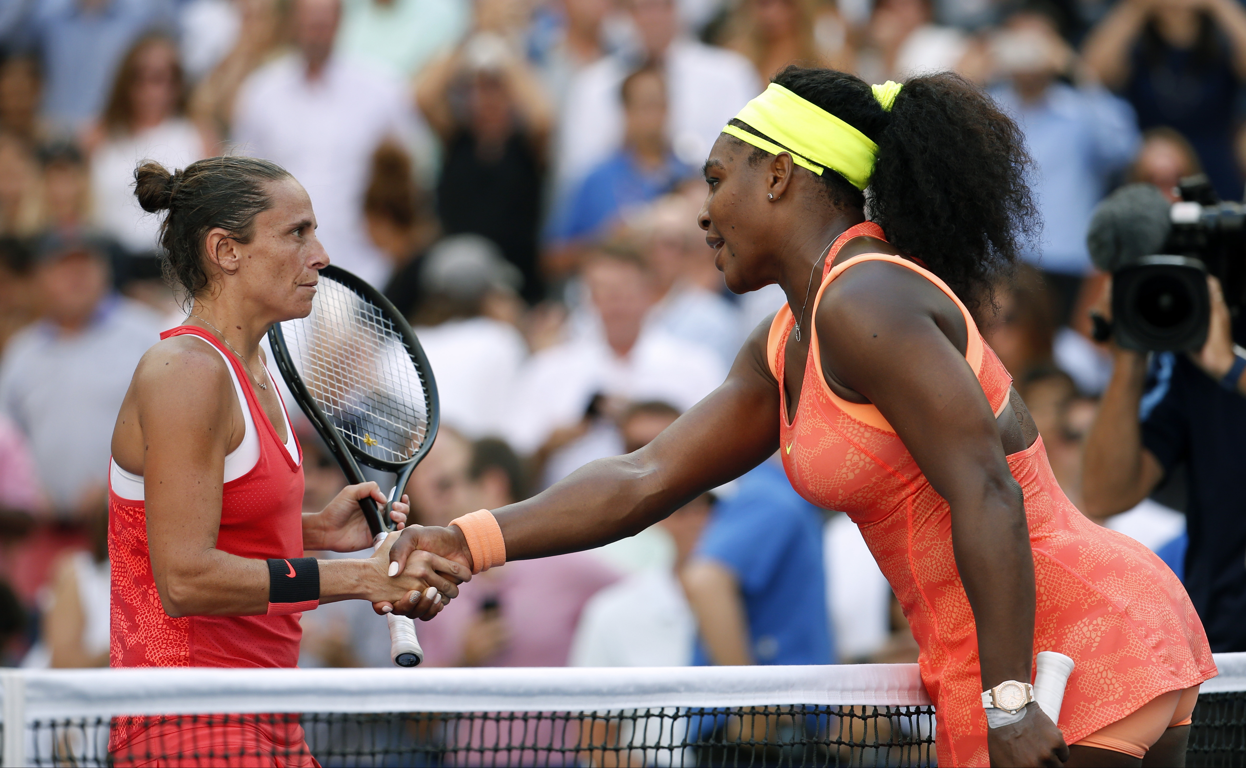 Roberta Vinci, of Italy, left, greets Serena Williams after winning their semifinal match at the U.S. Open tennis tournament, Friday, Sept. 11, 2015, in New York. (AP Photo/Julio Cortez)