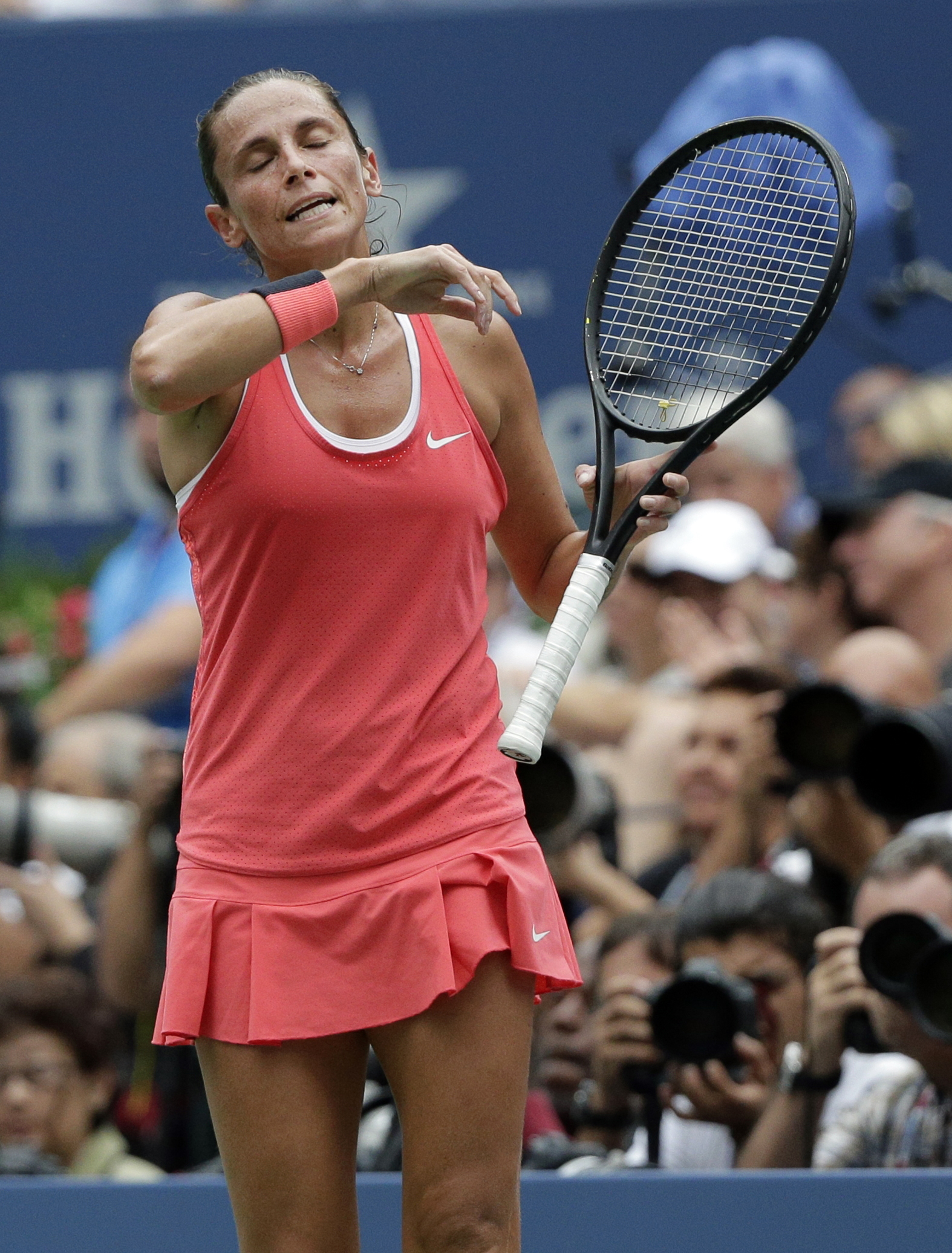 Roberta Vinci, of Italy, reacts after a point during the women's championship match with Flavia Pennetta, of Italy, of the U.S. Open tennis tournament, Saturday, Sept. 12, 2015, in New York. (AP Photo/Bill Kostroun)