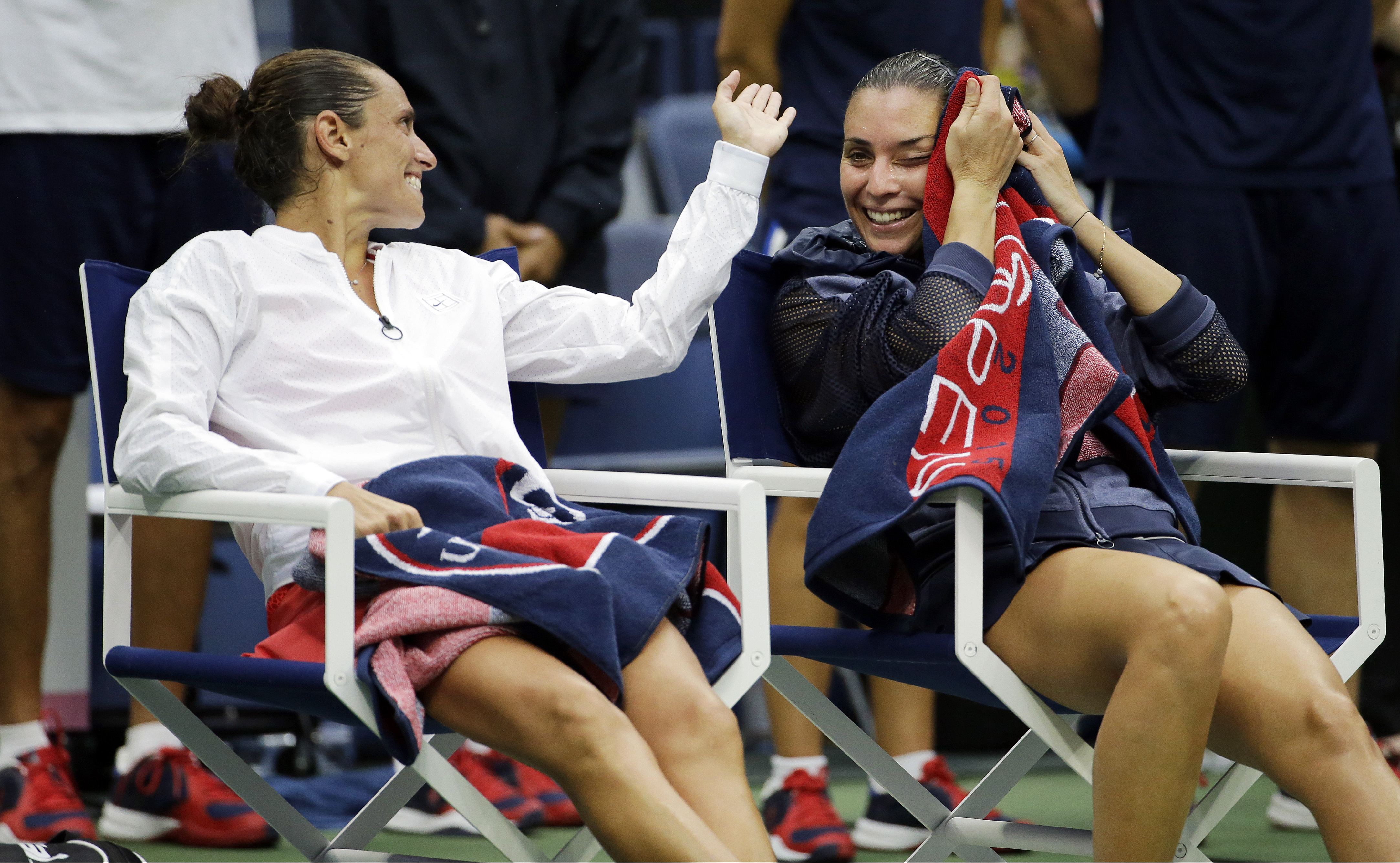 Roberta Vinci, of Italy, left, talks with Flavia Pennetta, of Italy, after Pennetta beat Vinci in the women's championship match of the U.S. Open tennis tournament, Saturday, Sept. 12, 2015, in New York. (AP Photo/David Goldman)
