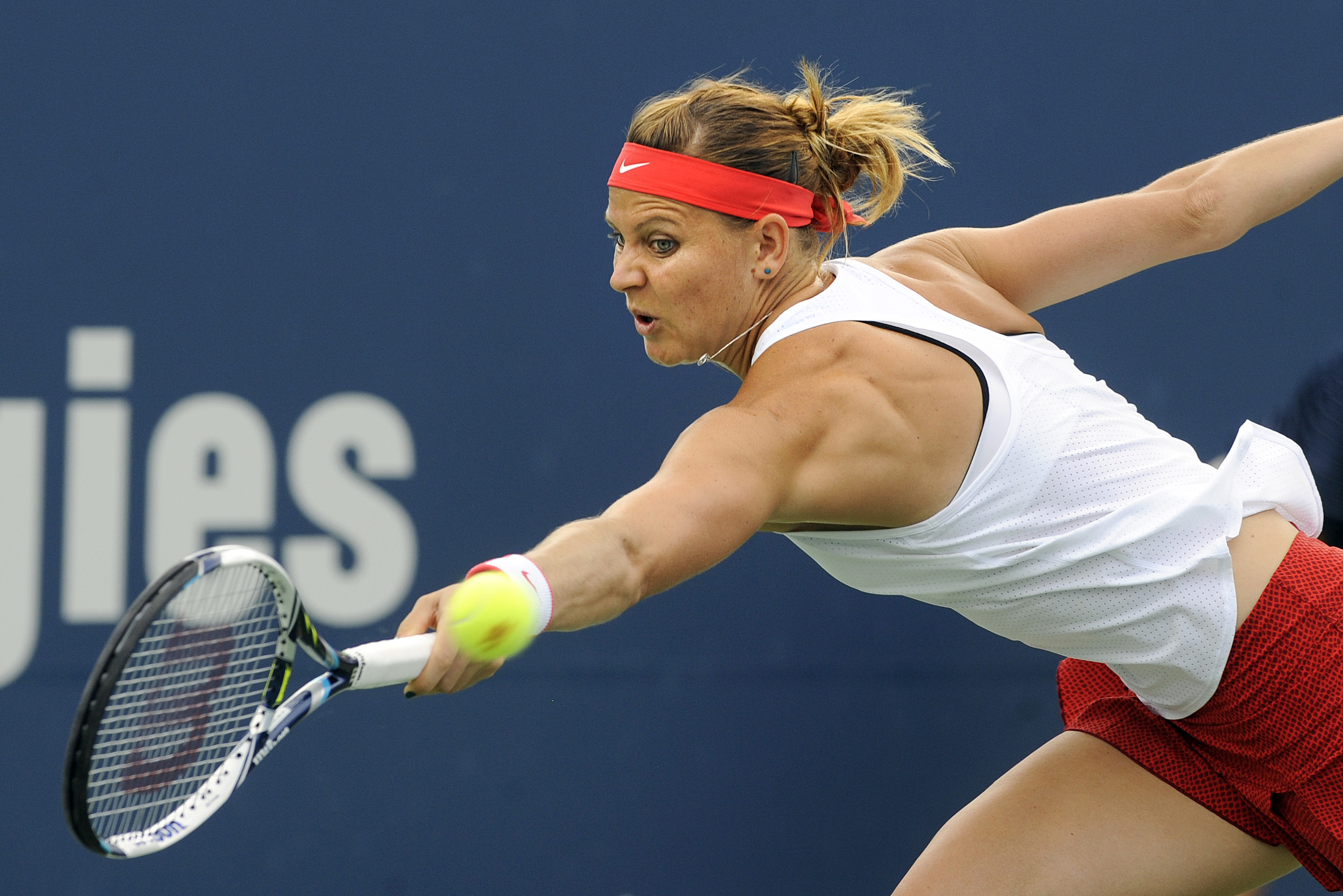 FILE - This is a Thursday, Aug. 27, 2015 file photo of Lucie Safarova, of the Czech Republic, as she  reaches for a backhand during her match against Dominika Cibulkova, of Slovakia, during the quartefinals of the Connecticut Open tennis tournament in New