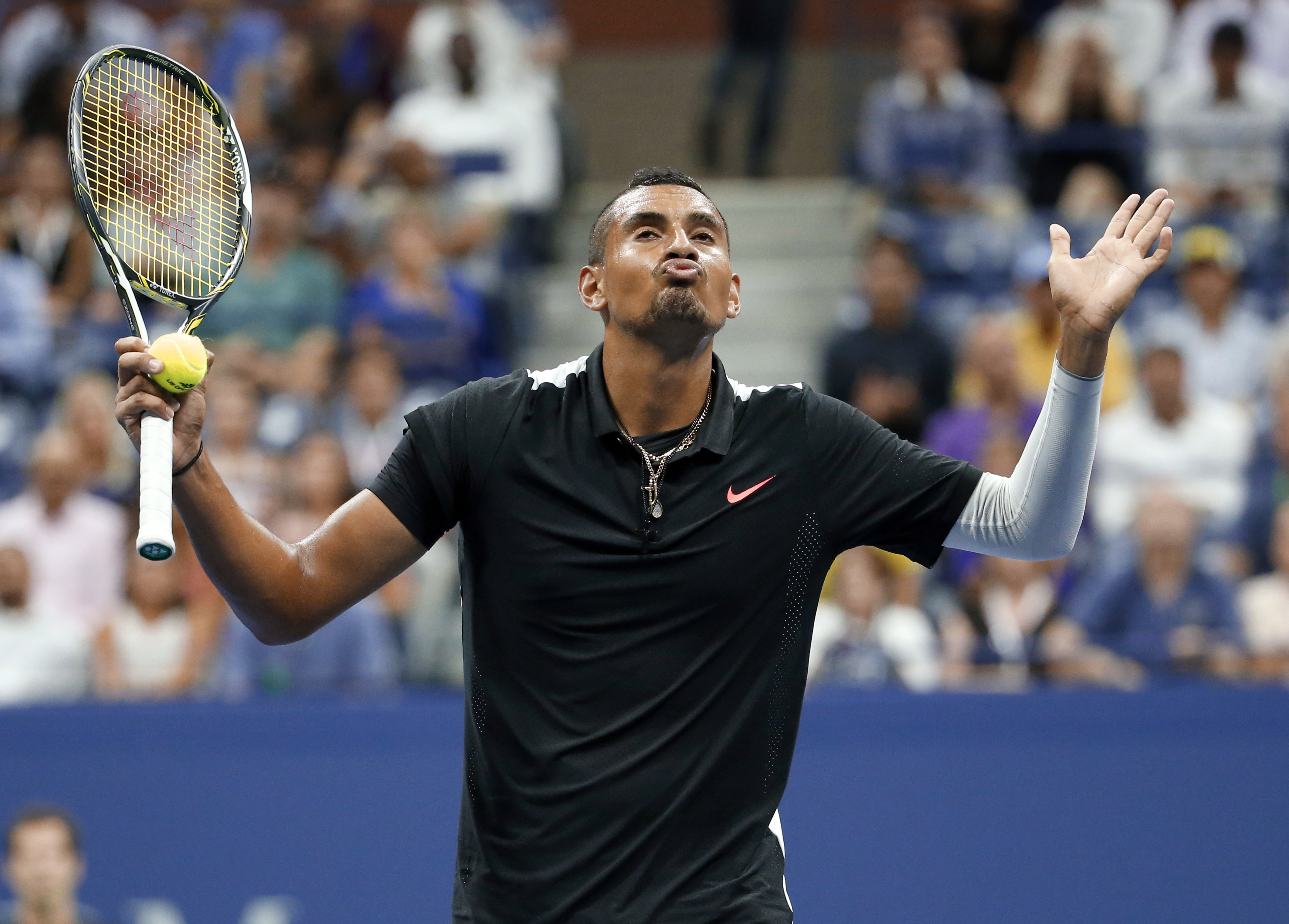 Nick Kyrgios, of Australia, reacts between points against Andy Murray, of Britain, during the first round of the U.S. Open tennis tournament in New York, Tuesday, Sept. 1, 2015. (AP Photo/Julio Cortez)