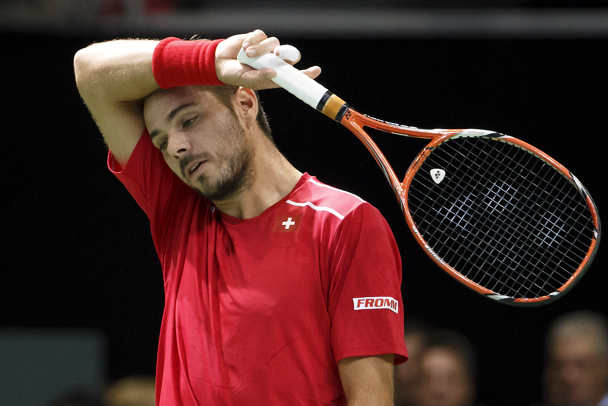 Stan Wawrinka of Switzerland reacts after losing a point against Thiemo De Bakker of the Netherlands during the first single match of the tennis Davis Cup World Group play-off round between Switzerland and the Netherlands in Geneva, Switzerland, Friday, S