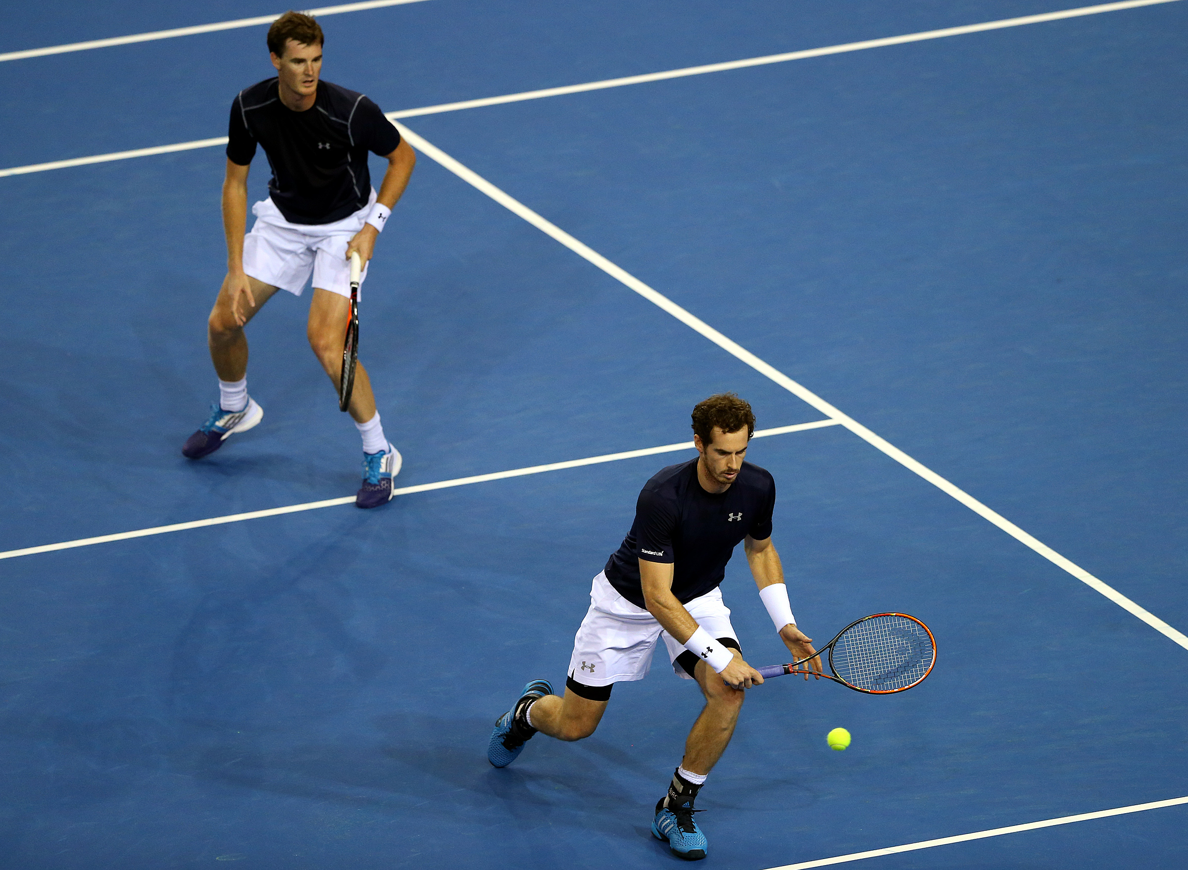 Britain's Andy Murray, right, and Jamie Murray plays a shot to Australia's Sam Groth and Lleyton Hewitt during the semifinal doubles tennis match between Britain and Australia of the Davis Cup in Glasgow, Saturday Sept. 19, 2015. (AP Photo/Scott Heppell)