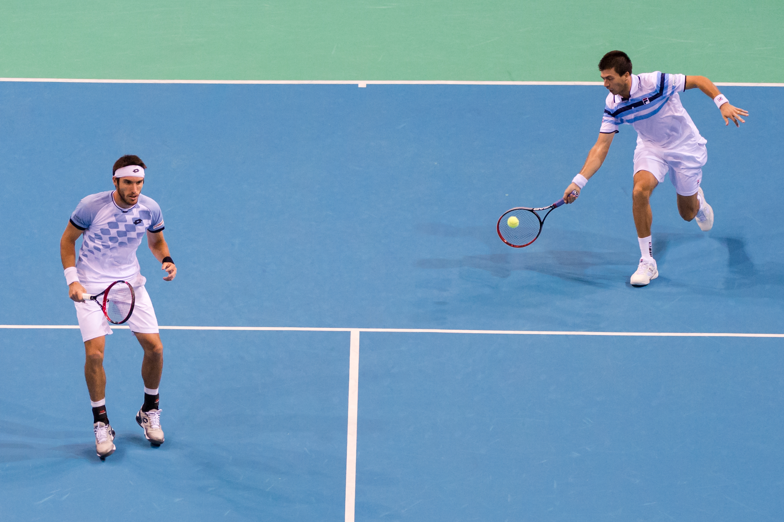 Argentina's Leonardo Mayer, left, and Carlos Berlocq return the ball to Belgium's Steve Darcis and Ruben Bemelmans during the doubles match at the Davis Cup World Group semifinals between Belgium and Argentina in Brussels, Saturday, Sept. 19, 2015. (AP Ph