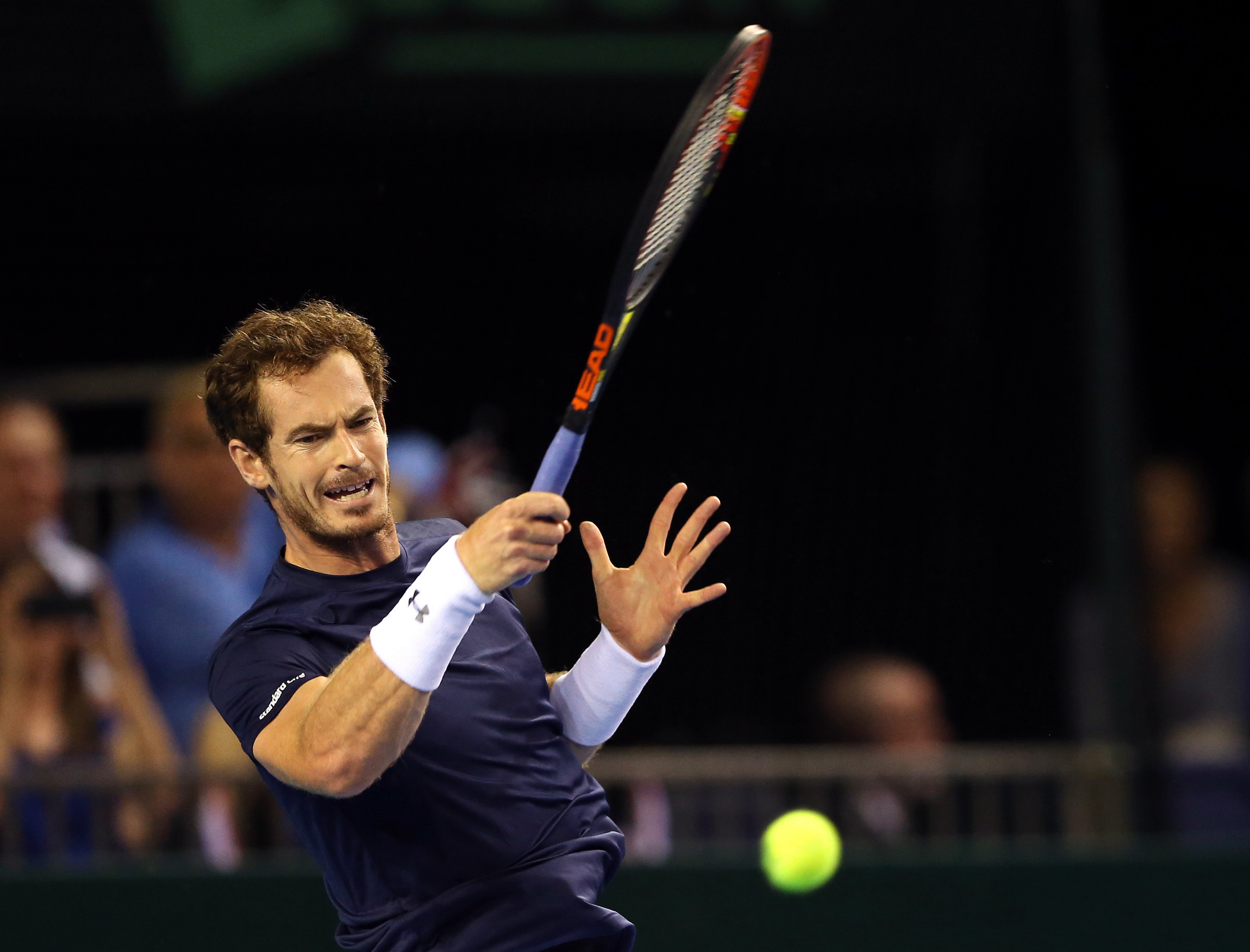 Britain's Andy Murray plays a return to Australia's Bernard Tomic during a semifinal tennis match of the Davis Cup between Britain and Australia in Glasgow, Scotland, Sunday Sept. 20, 2015. (AP Photo/Scott Heppell)