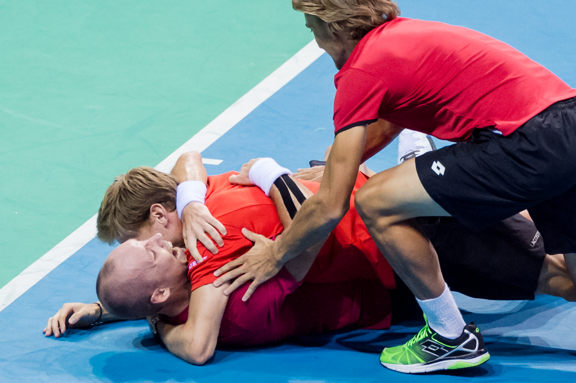 Belgium's Steve Darcis celebrates after winning against Argentina's Federico Delbonis during the last singles match at the Davis Cup World Group semifinals between Belgium and Argentina in Brussels, Sunday, Sept. 20, 2015. Belgium qualifies for the Davis