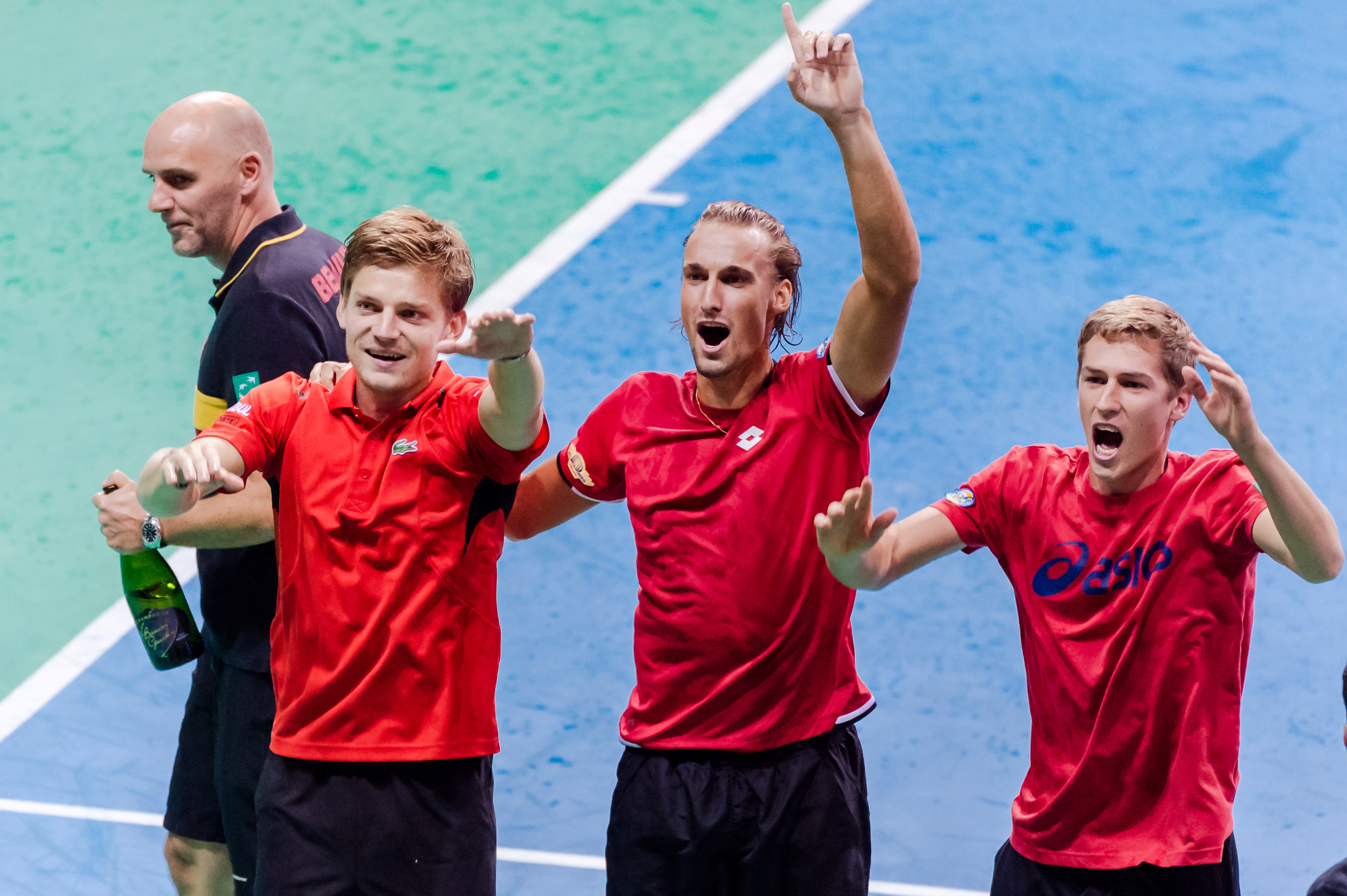 Belgian Davis Cup team captain Johan Van Herck, left, and team members David Goffin, second left, Ruben Bemelmans, second right, and Kimmer Coppejans celebrate after winning the Davis Cup World Group semifinals against Argentina in Brussels, Sunday, Sept.