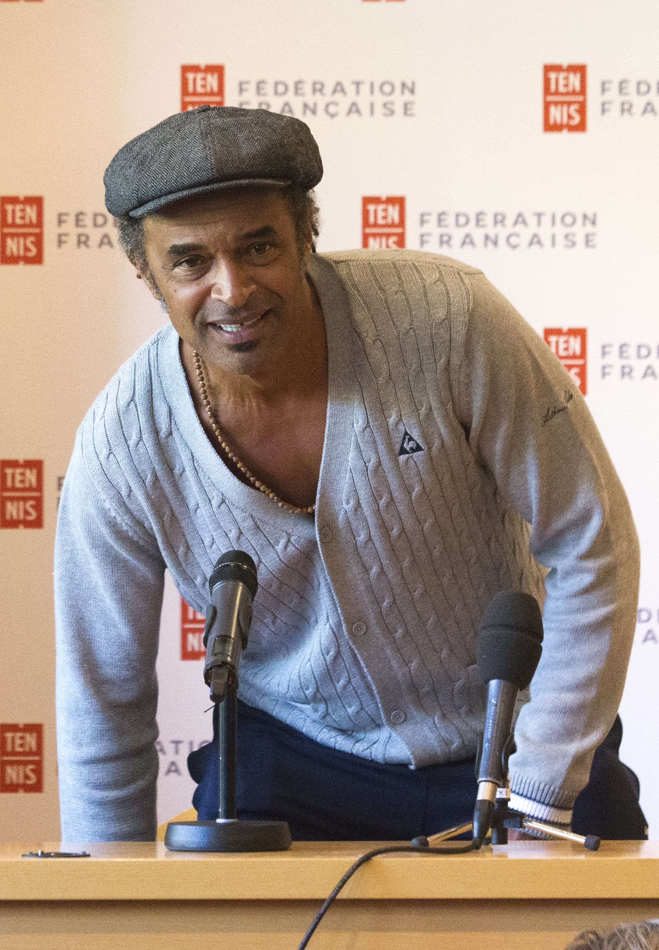 Yannick Noah, the last Frenchman to win a Grand Slam tournament, arrives at a  press conference at the Roland Garros stadium in Paris, France, Tuesday, Sept. 22, 2015. Noah has been appointed as the new France Davis Cup captain Monday. (AP Photo/Jacques B