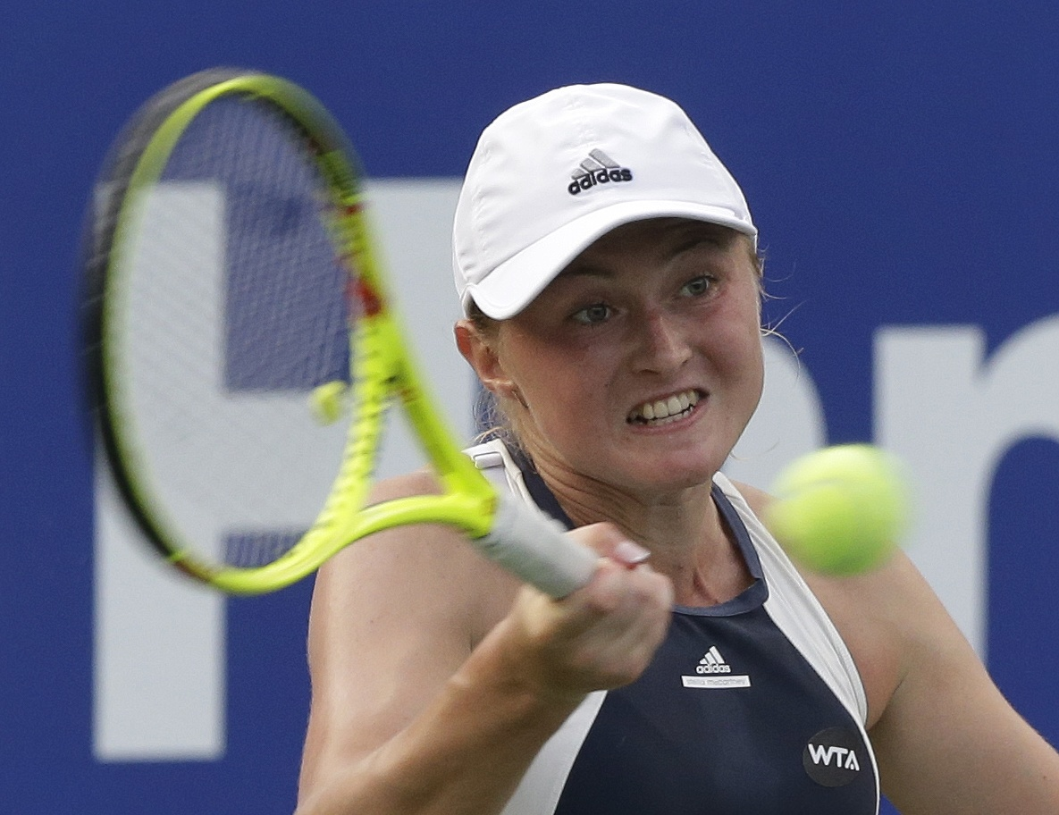 Aliaksandra Sasnovich of Belarus returns a shot against Sloane Stephens of the United States during the quarterfinal match of the Korea Open tennis championships in Seoul, South Korea, Friday, Sept. 25, 2015. (AP Photo/Ahn Young-joon)