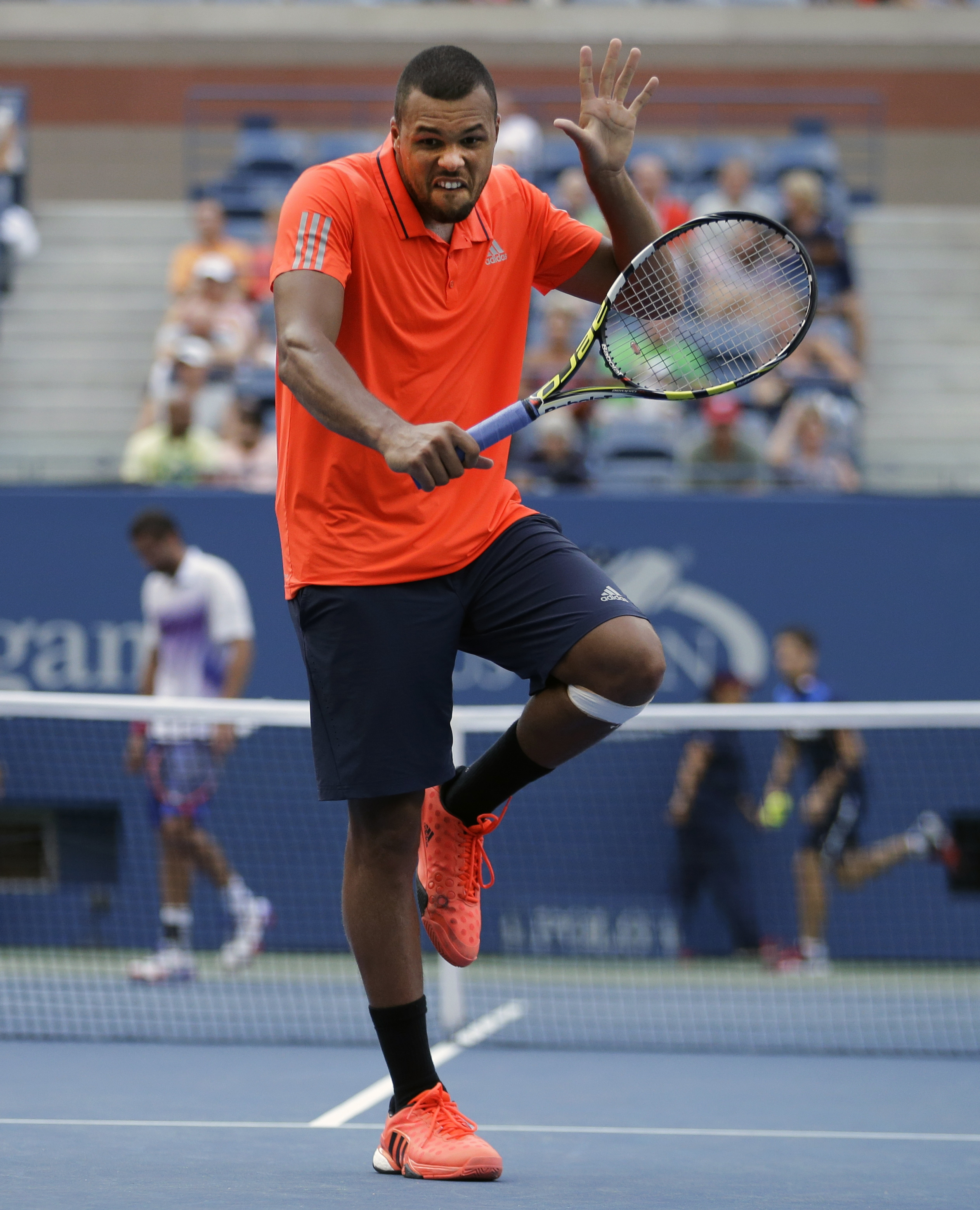 Jo-Wilfried Tsonga, of France, reacts after a shot to Marin Cilic, of Croatia, during a quarterfinal match at the U.S. Open tennis tournament, Tuesday, Sept. 8, 2015, in New York. (AP Photo/David Goldman)