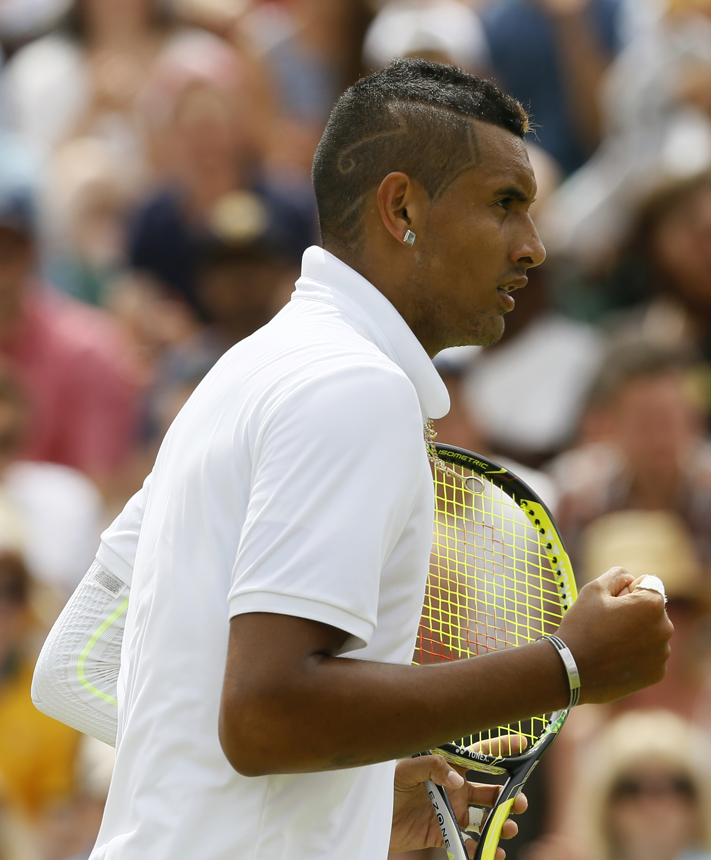 Nick Kyrgios of Australia celebrates winning a point against Richard Gasquet of France, during their singles match at the All England Lawn Tennis Championships in Wimbledon, London, Monday July 6, 2015. (AP Photo/Kirsty Wigglesworth)