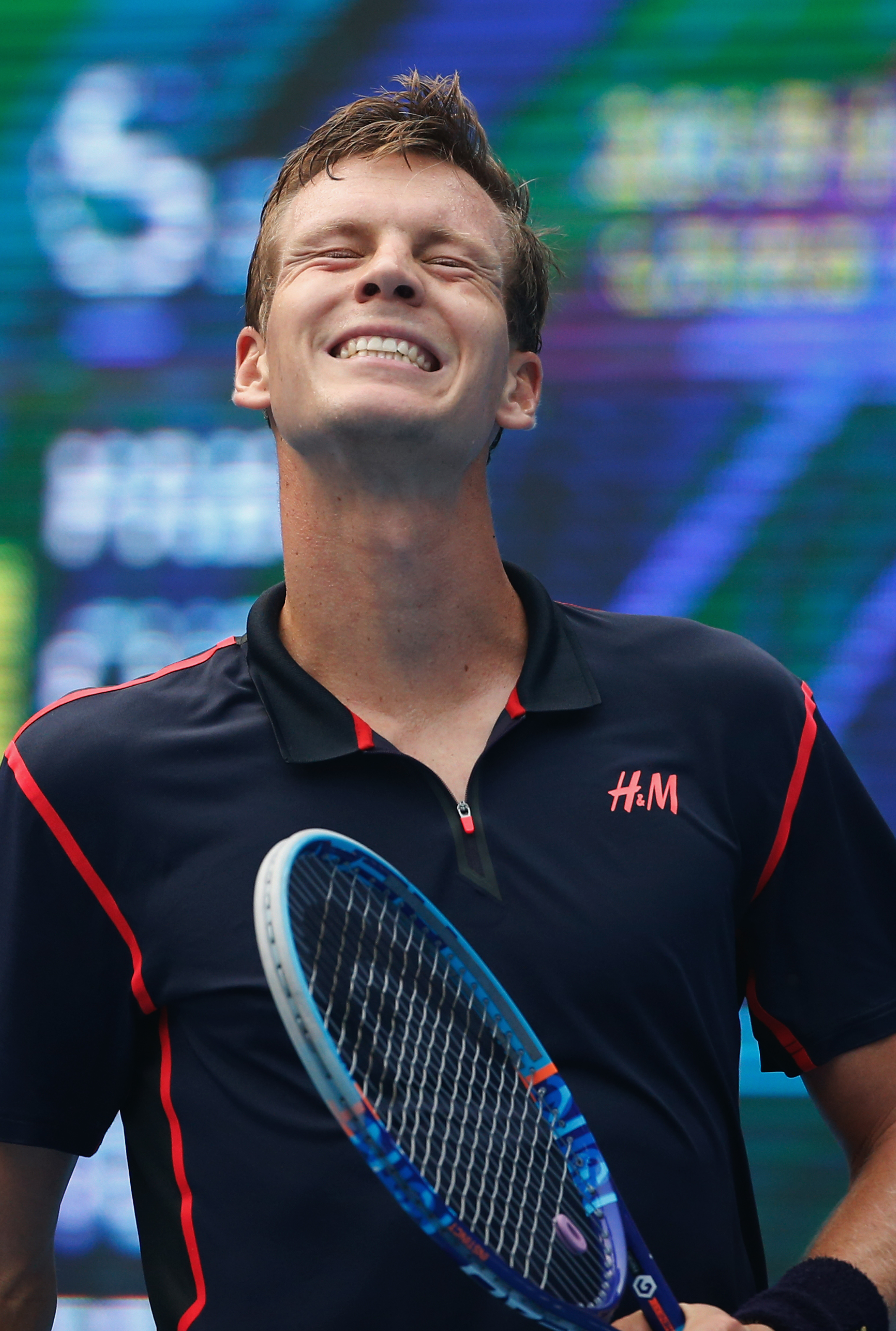 Tomas Berdych of the Czech Republic reacts after missing a point to Pablo Cuevas of Uruguay during their men's singles match of the China Open tennis tournament at the National Tennis Stadium in Beijing, Wednesday, Oct. 7, 2015. (AP Photo/Andy Wong)