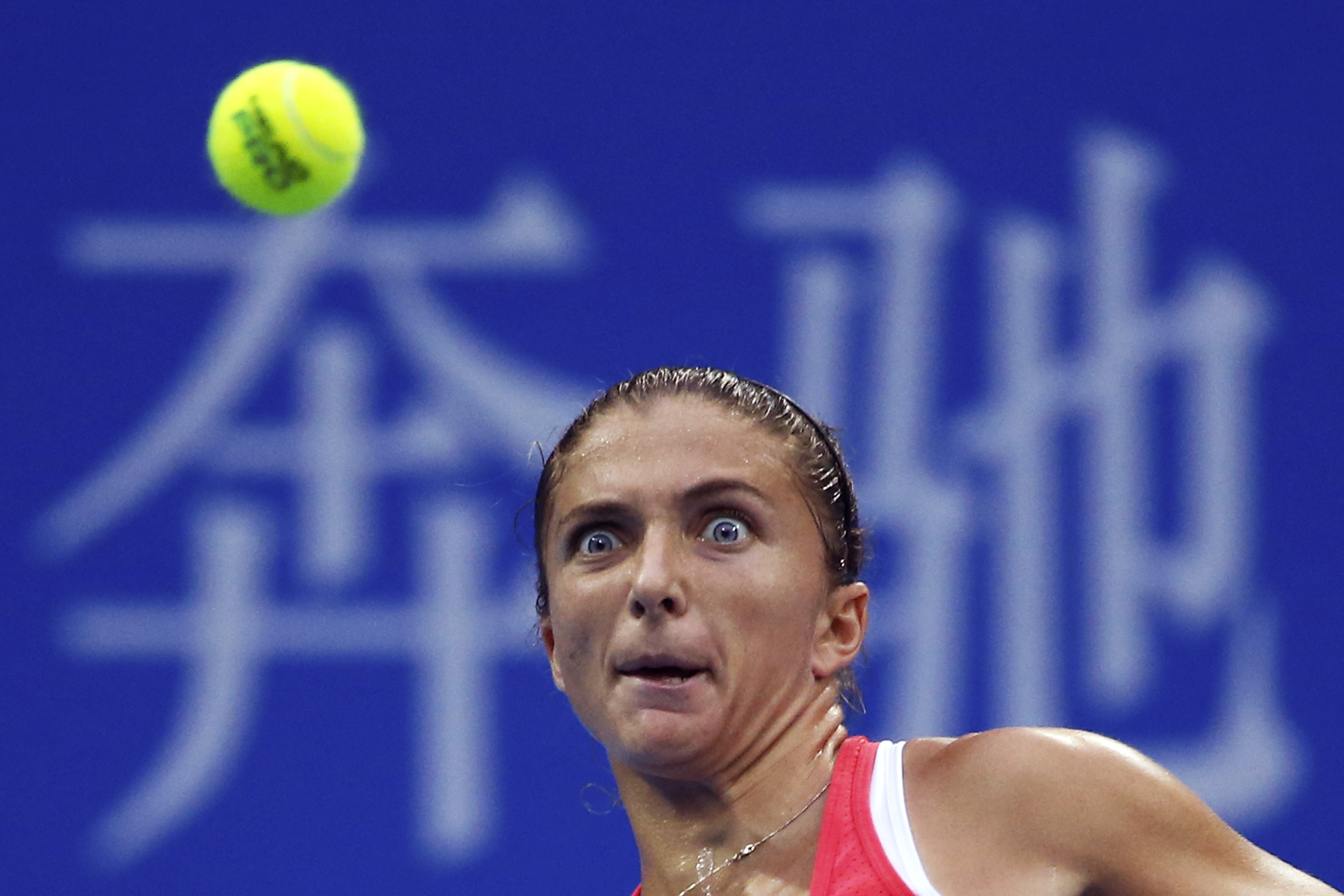 Sara Errani of Italy eyes on the ball as she plays against Andrea Petkovic of Germany during their third round women's singles match of the China Open tennis tournament at the National Tennis Stadium in Beijing, Wednesday, Oct. 7, 2015. (AP Photo/Andy Won