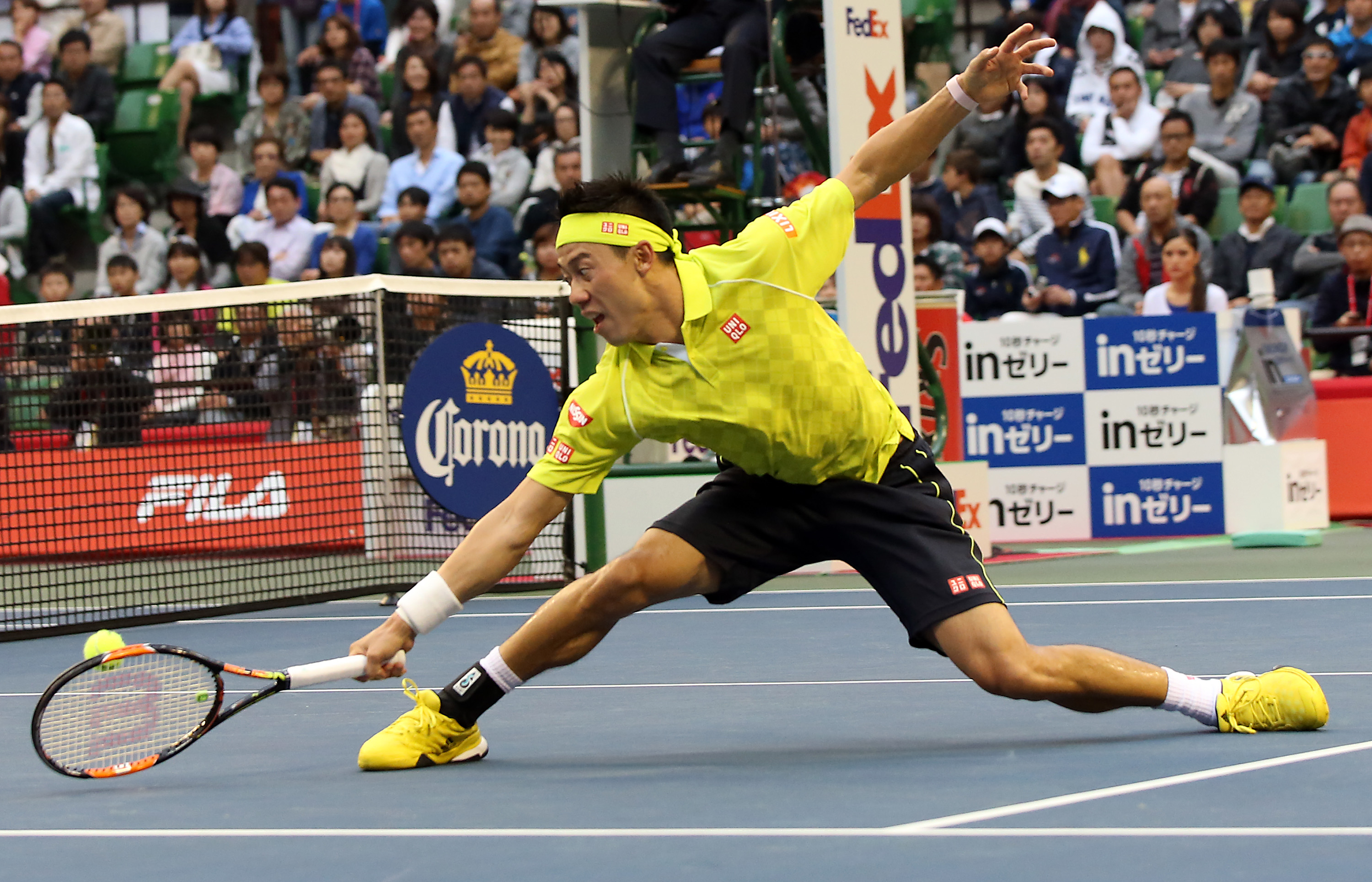 Kei Nishikori of Japan returns a shot against Benoit Paire of France during their singles semifinal match at the Japan Open men's tennis tournament in Tokyo, Saturday, Oct. 10, 2015. (AP Photo/Eugene Hoshiko)