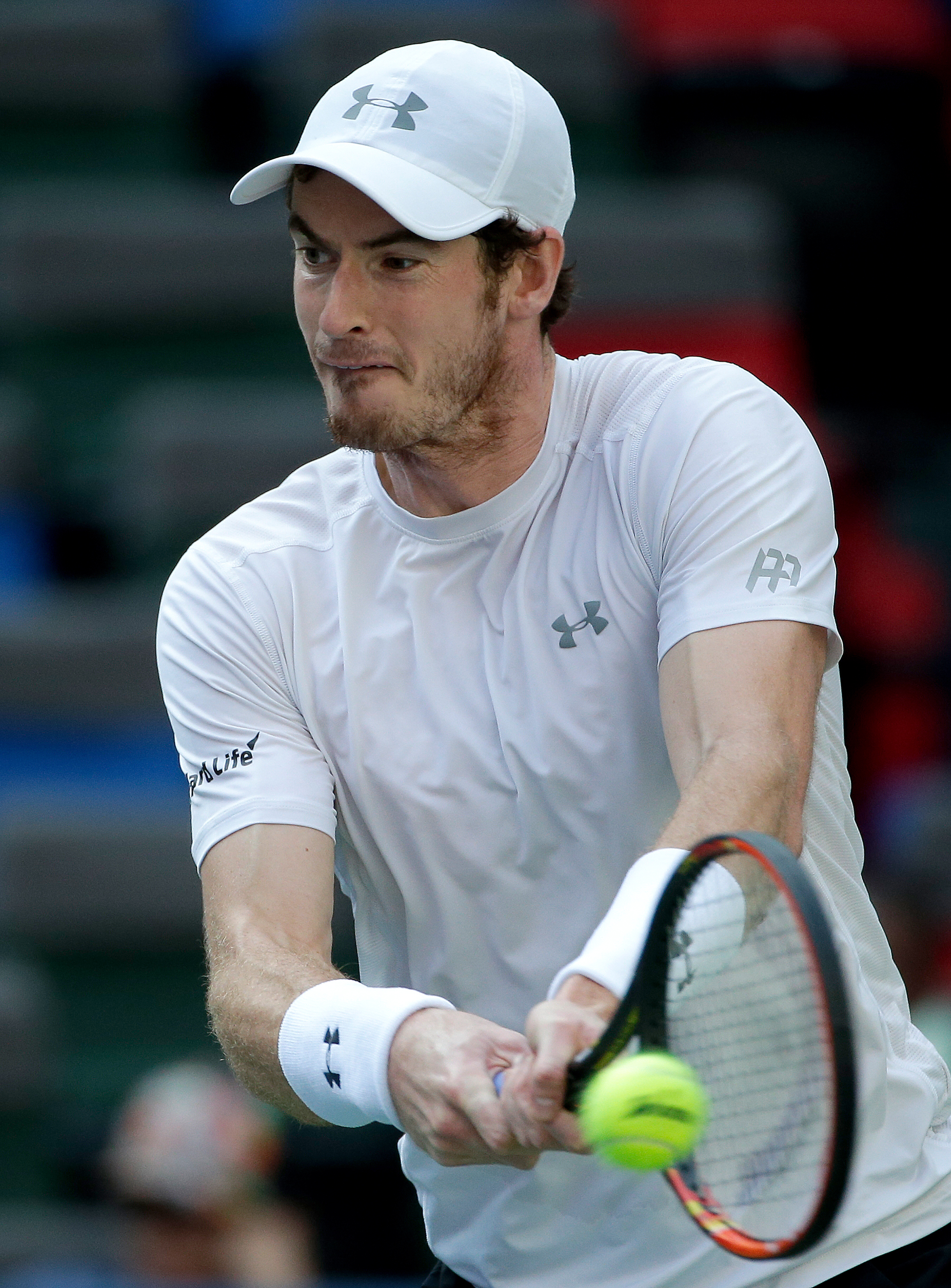 Andy Murray of Britain hits a return shot as he plays against John Isner of the United States in the Shanghai Masters tennis tournament in Shanghai, China, Thursday, Oct. 15, 2015. (AP Photo/Andy Wong)