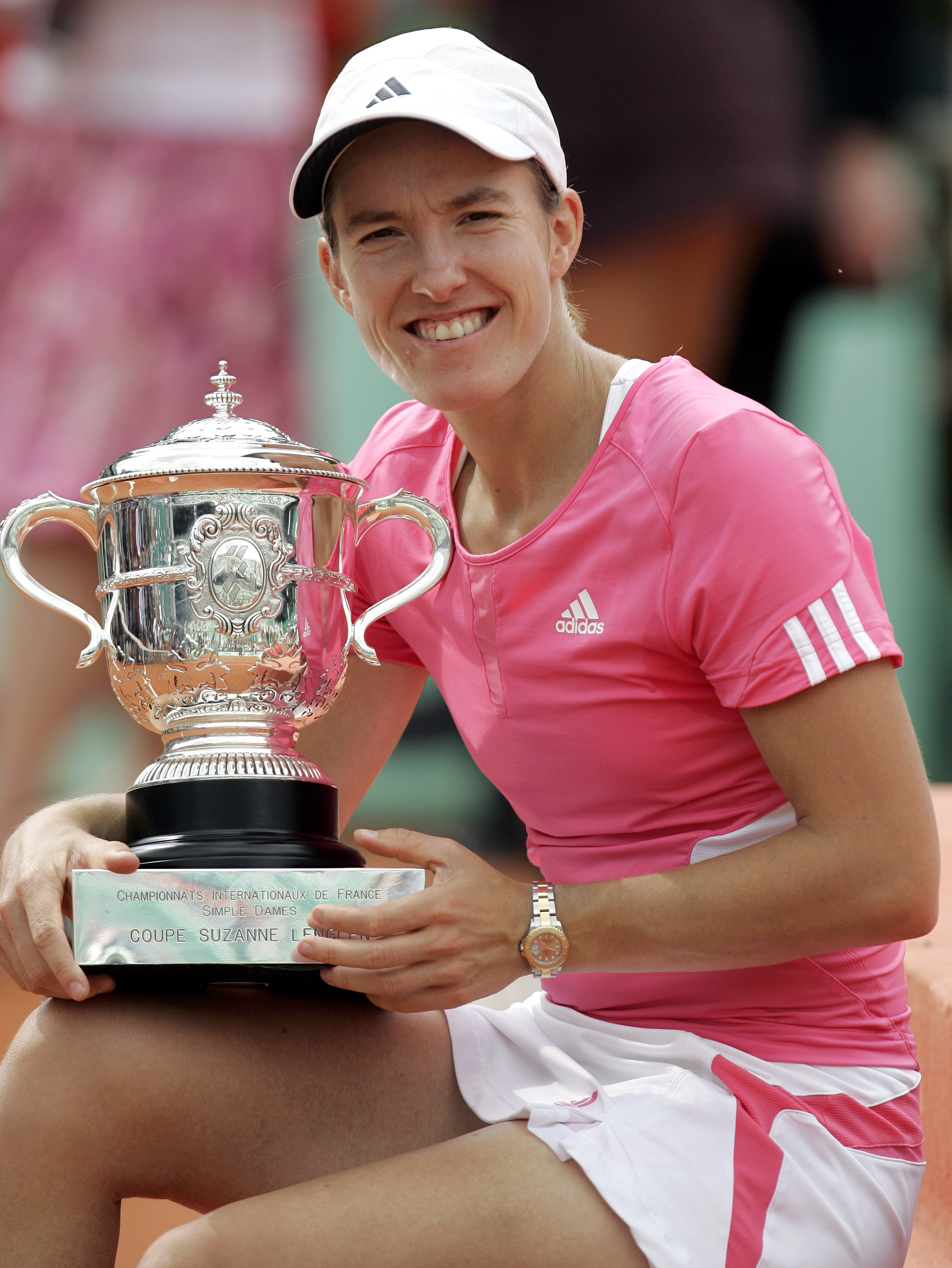 FILE - In this June 9, 2007, file photo, Belgium's Justine Henin poses with the trophy after beating Serbia's Ana Ivanovic in the women's final match of the French Open tennis tournament at Roland Garros stadium in Paris. Justine Henin and Marat Safin, wh