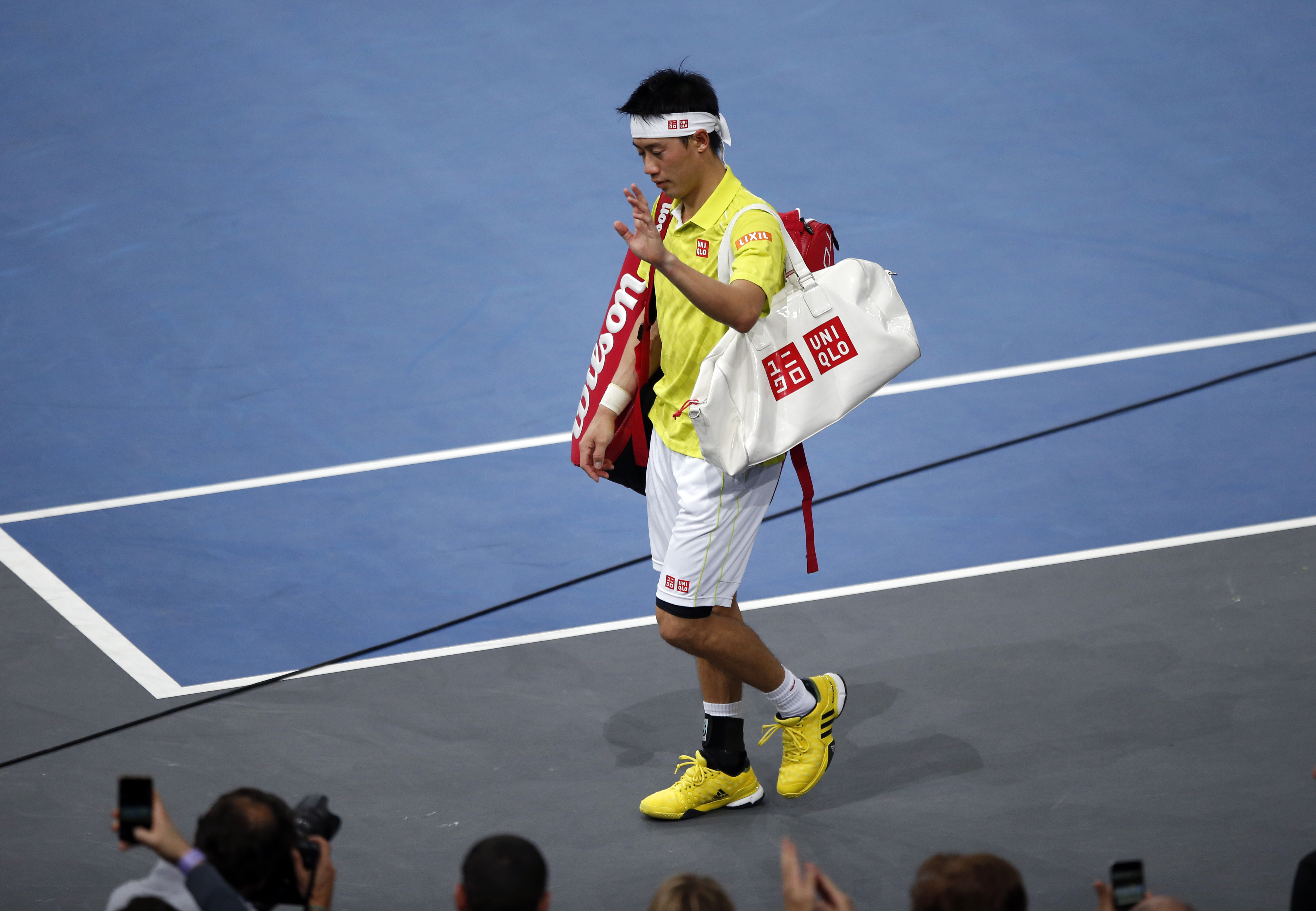 Japan's Kei Nishikori leaves the court after retiring against France's Richard Gasquet during their round of sixteen match of the BNP Masters tennis tournament, at the Paris refurbished Bercy Arena, in Paris, France, Thursday, Nov. 5, 2015. (AP Photo/Fran