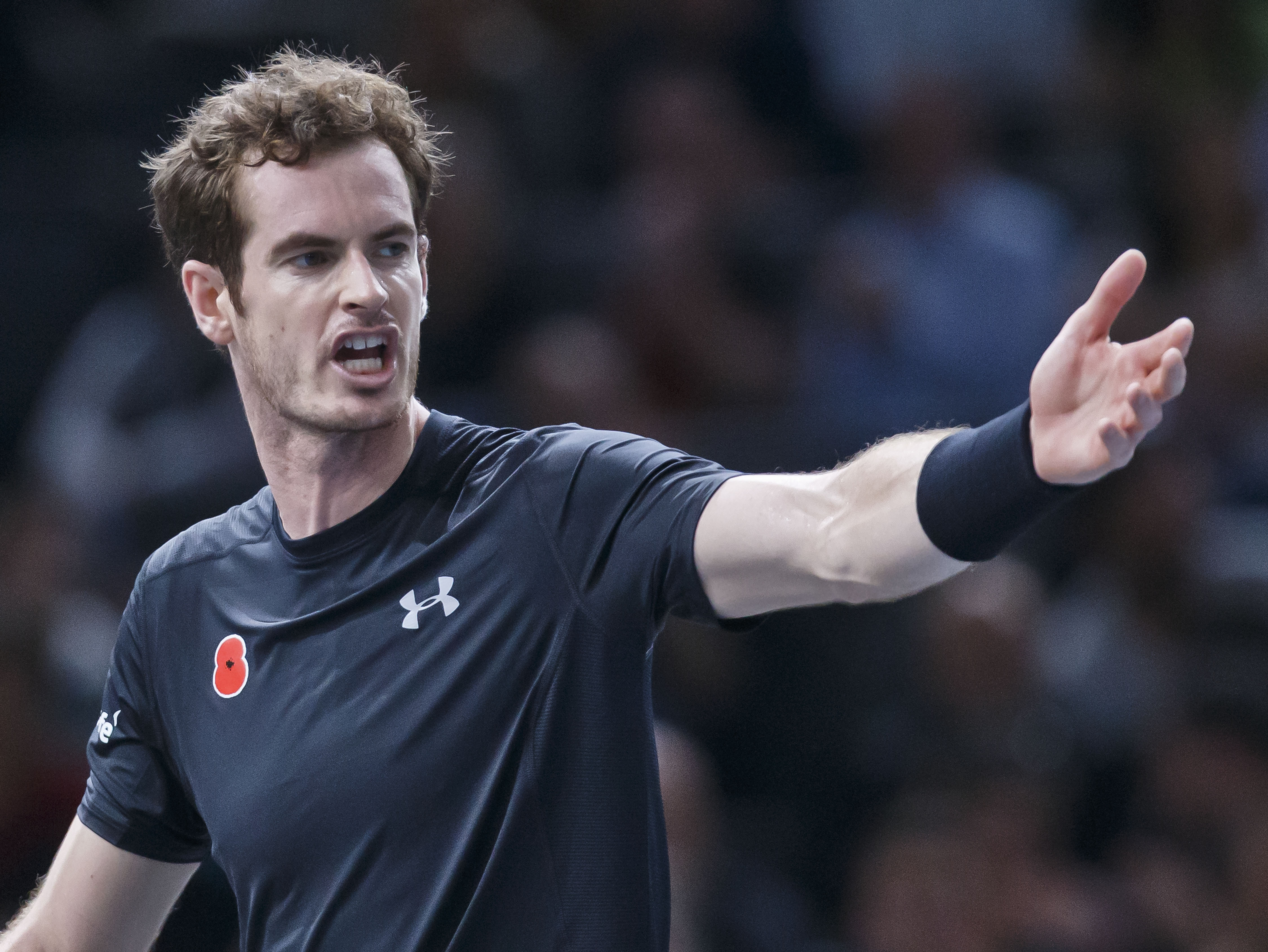 Britain's Andy Murray reacts after losing a point against France's Richard Gasquet during their quarterfinal match of the BNP Masters tennis tournament at the Paris Bercy Arena, in Paris, France, Friday, Nov. 6, 2015. Murray won 7-6, 3-6, 6-3. (AP Photo/M