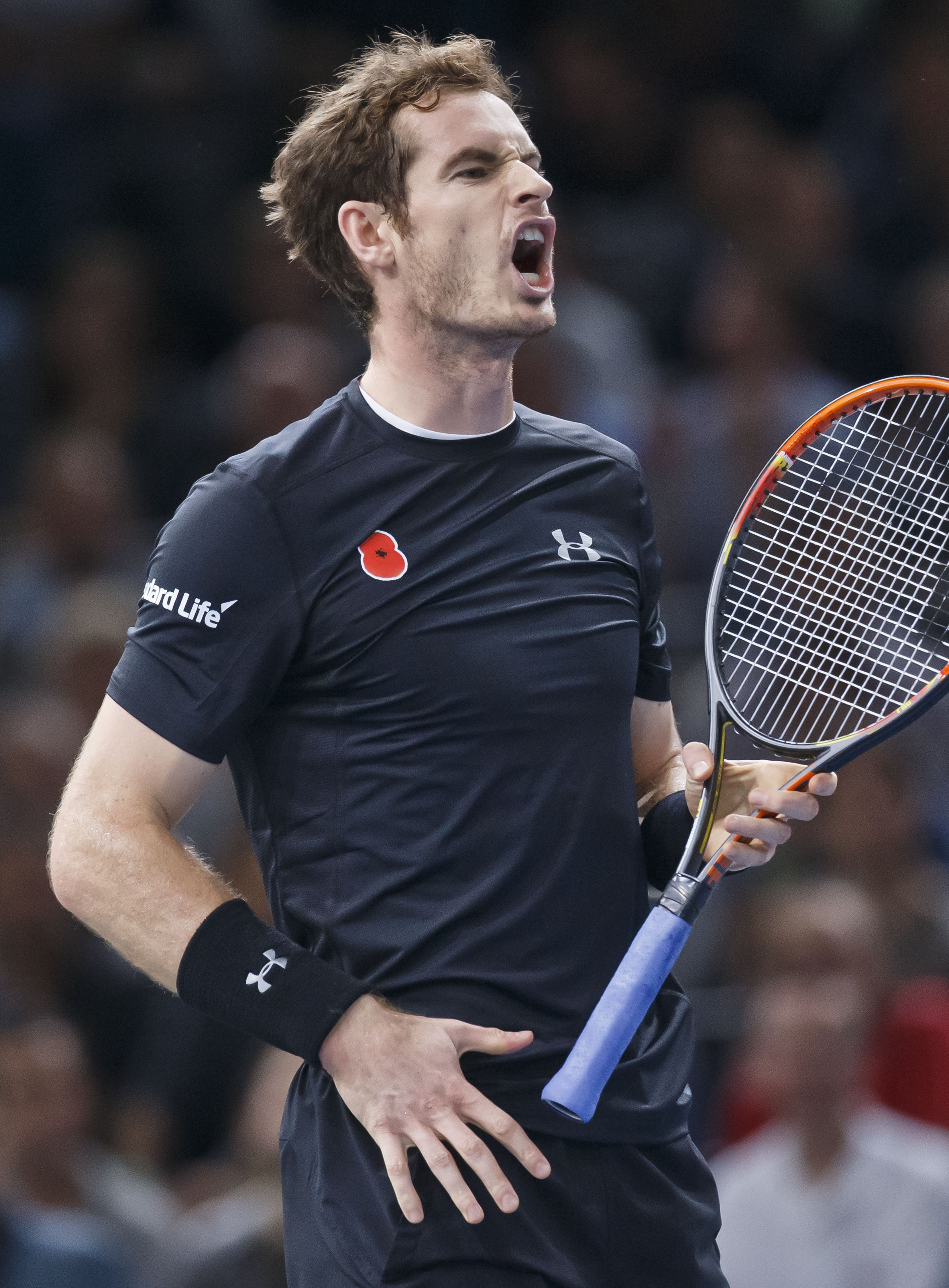 Britain's Andy Murray reacts after losing a point against Spain's David Ferrer during their semifinal match of the BNP Masters tennis tournament at the Paris Bercy Arena, in Paris, France, Saturday, Nov. 7, 2015. (AP Photo/Michel Euler)
