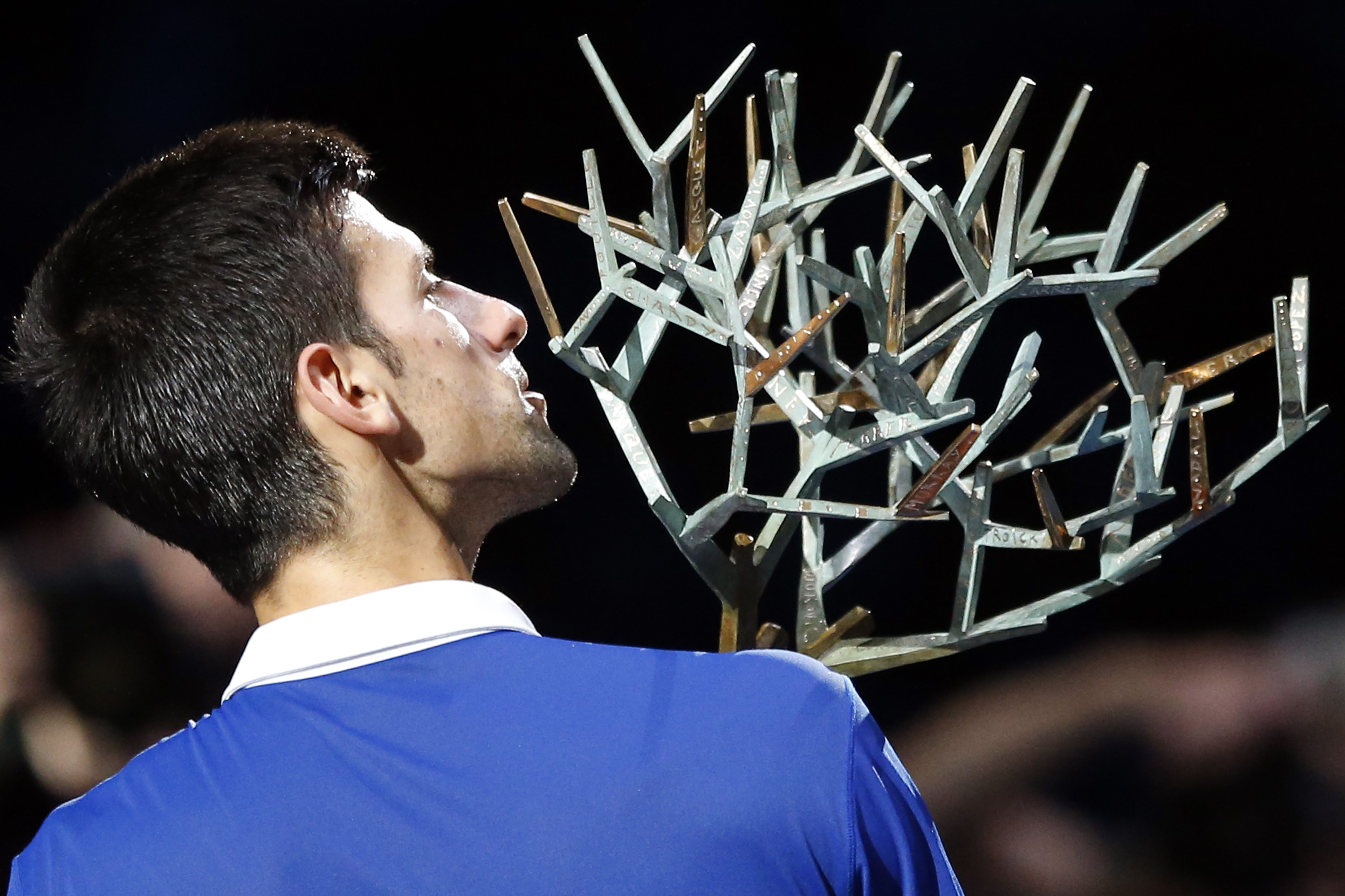 Serbia's Novak Djokovic poses with the trophy after winning Britain's Andy Murrray during their final match of the BNP Masters tennis tournament at the Paris Bercy Arena in Paris, France, Sunday, Nov. 8, 2015. Djokovic wins 6-2, 6-4. (AP Photo/Francois Mo