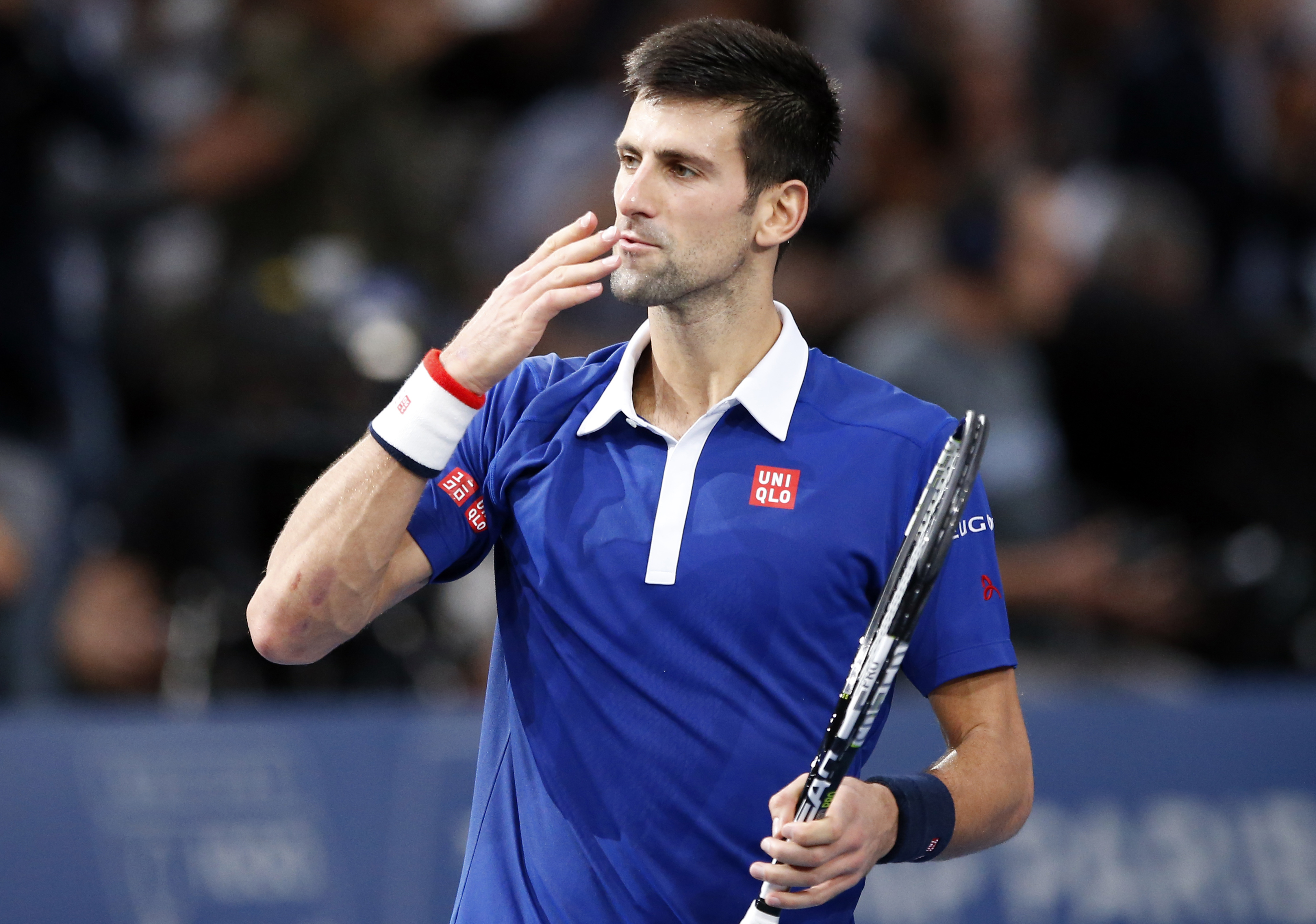Serbia's Novak Djokovic blows a kiss on the match point to win Britain's Andy Murrray during their final match of the BNP Masters tennis tournament at the Paris Bercy Arena in Paris, France, Sunday, Nov. 8, 2015. Djokovic wins 6-2, 6-4. (AP Photo/Francois