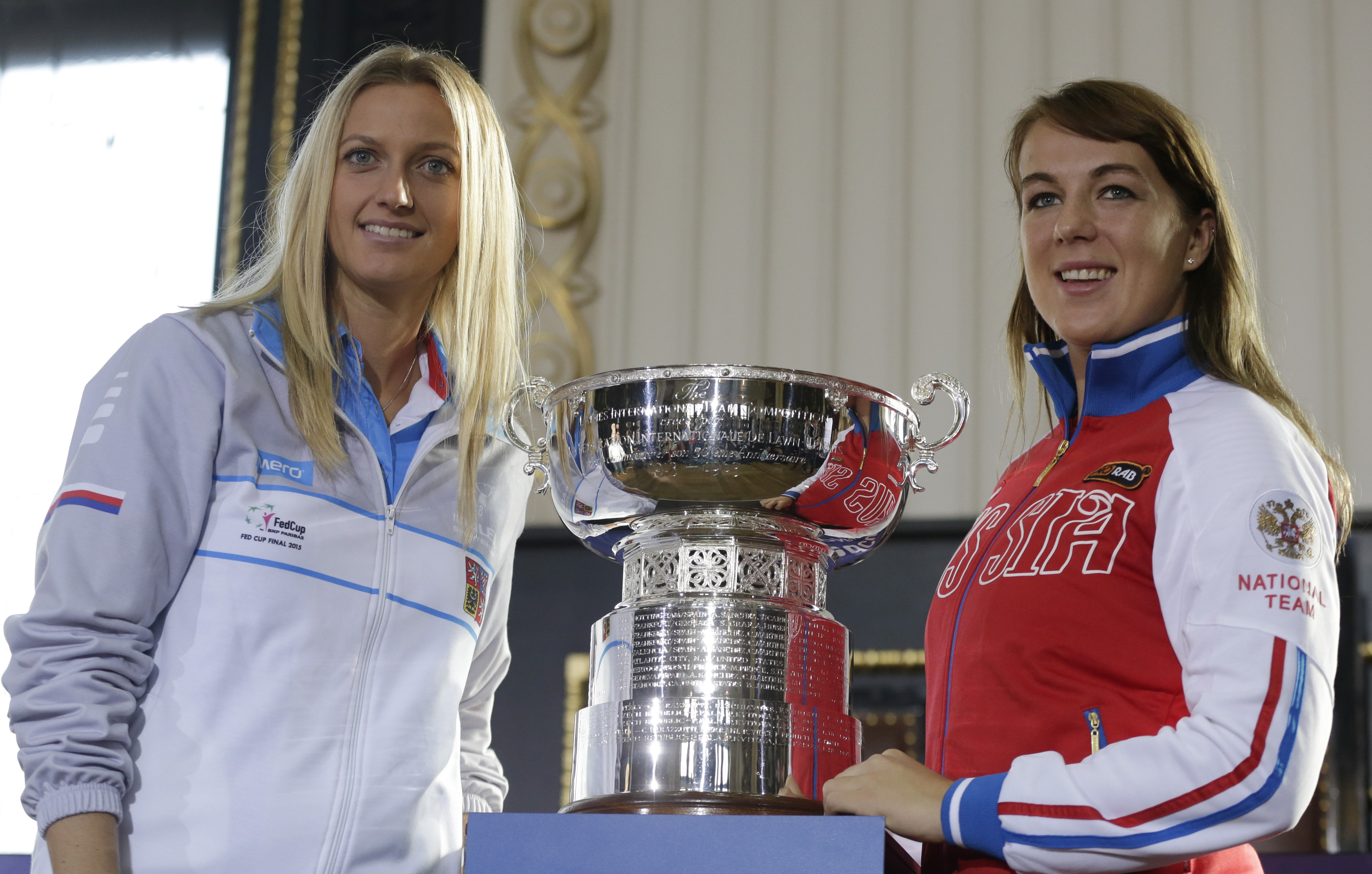 Petra Kvitova, left, of the Czech Republic and Anastasia Pavlyuchenkova, right, of Russia pose for a photo after the draw for the tennis Fed Cup Final between Czech Republic and Russia in Prague, Czech Republic, Friday, Nov. 13, 2015. (AP Photo/Petr David