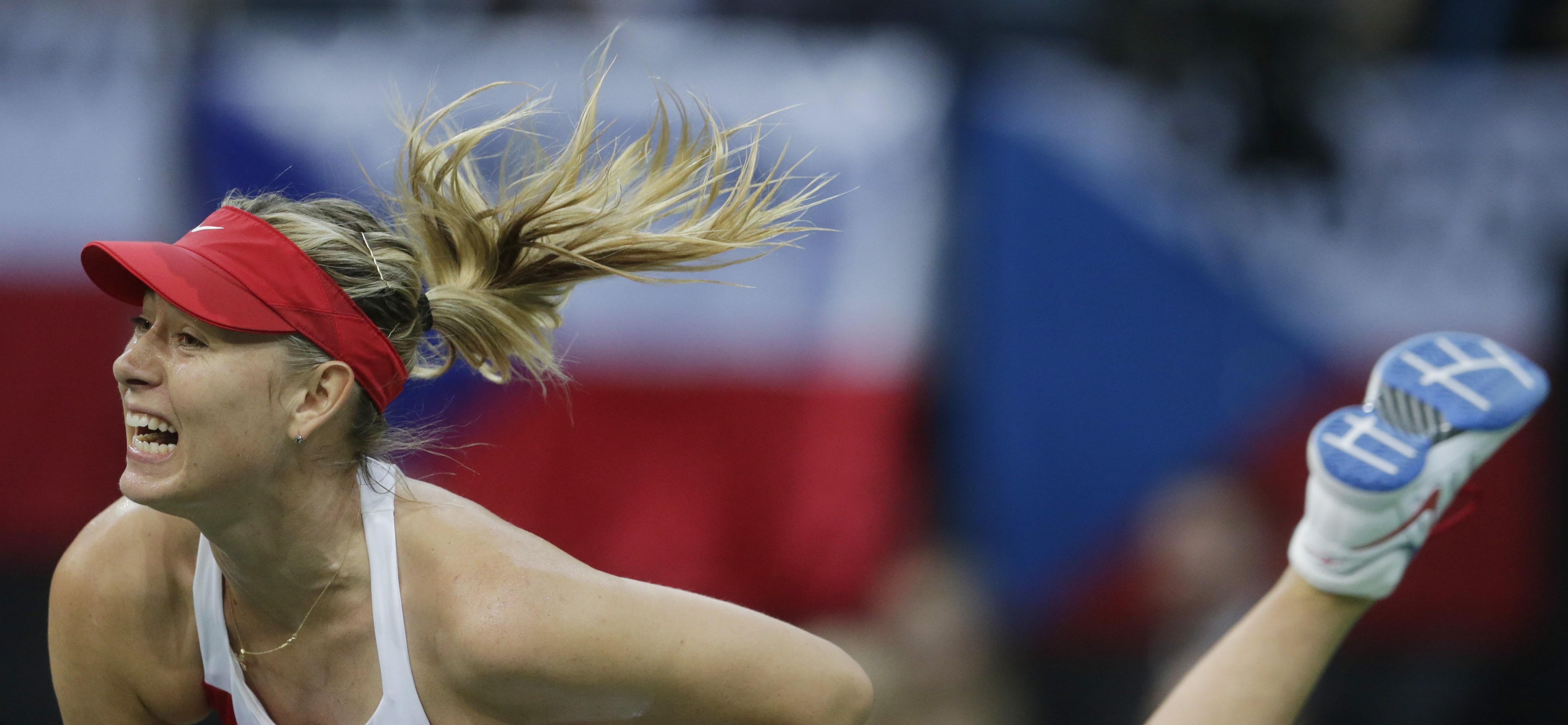 Russia's Maria Sharapova  serves  to Czech Republic's Petra Kvitova during their Fed Cup tennis final match between Czech Republic and Russia in Prague, Czech Republic, Sunday, Nov. 15, 2015. (AP Photo/Petr David Josek)
