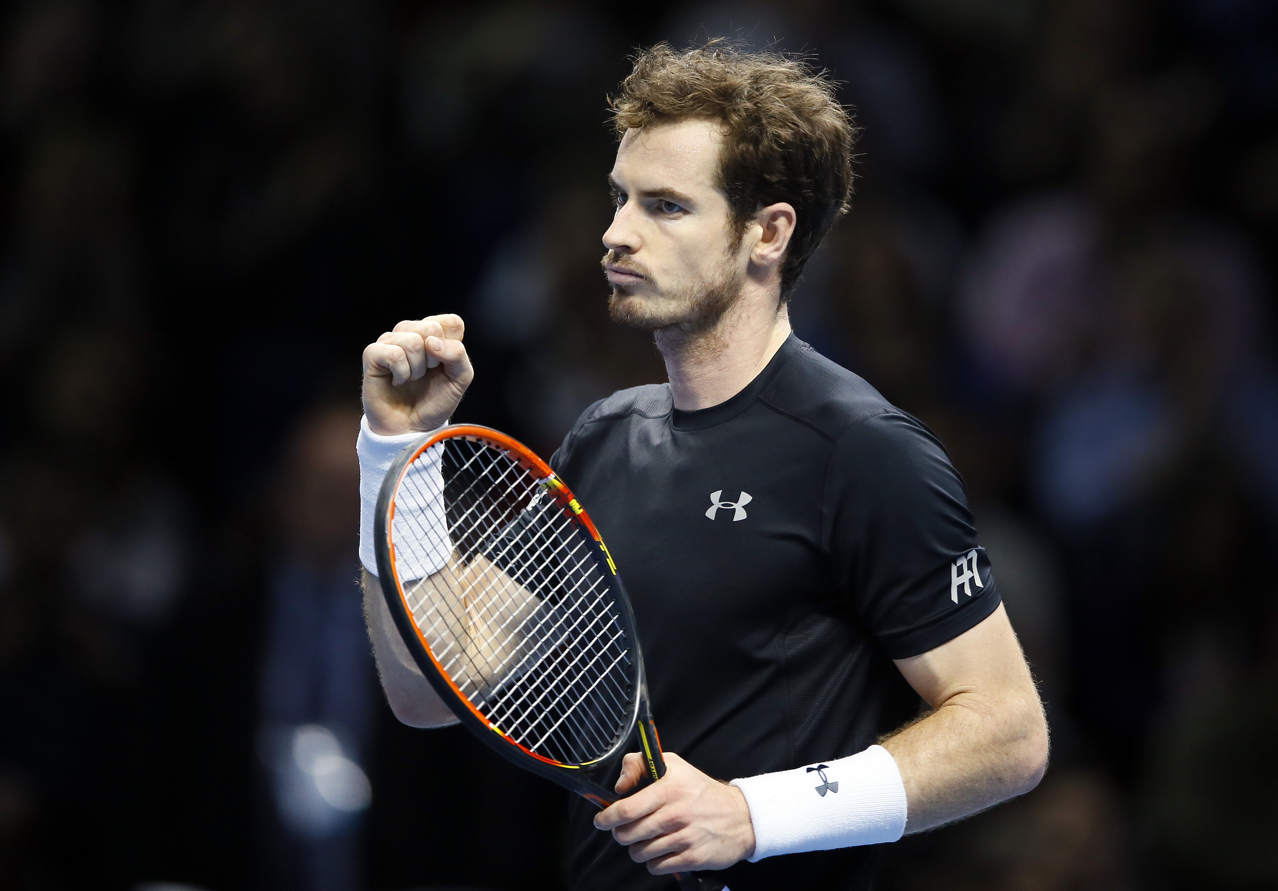 Andy Murray of Britain celebrates after winning match point against David Ferrer of Spain during their singles tennis match at the ATP World Tour Finals at the O2 Arena in London, Monday, Nov. 16, 2015. (AP Photo/Kirsty Wigglesworth)