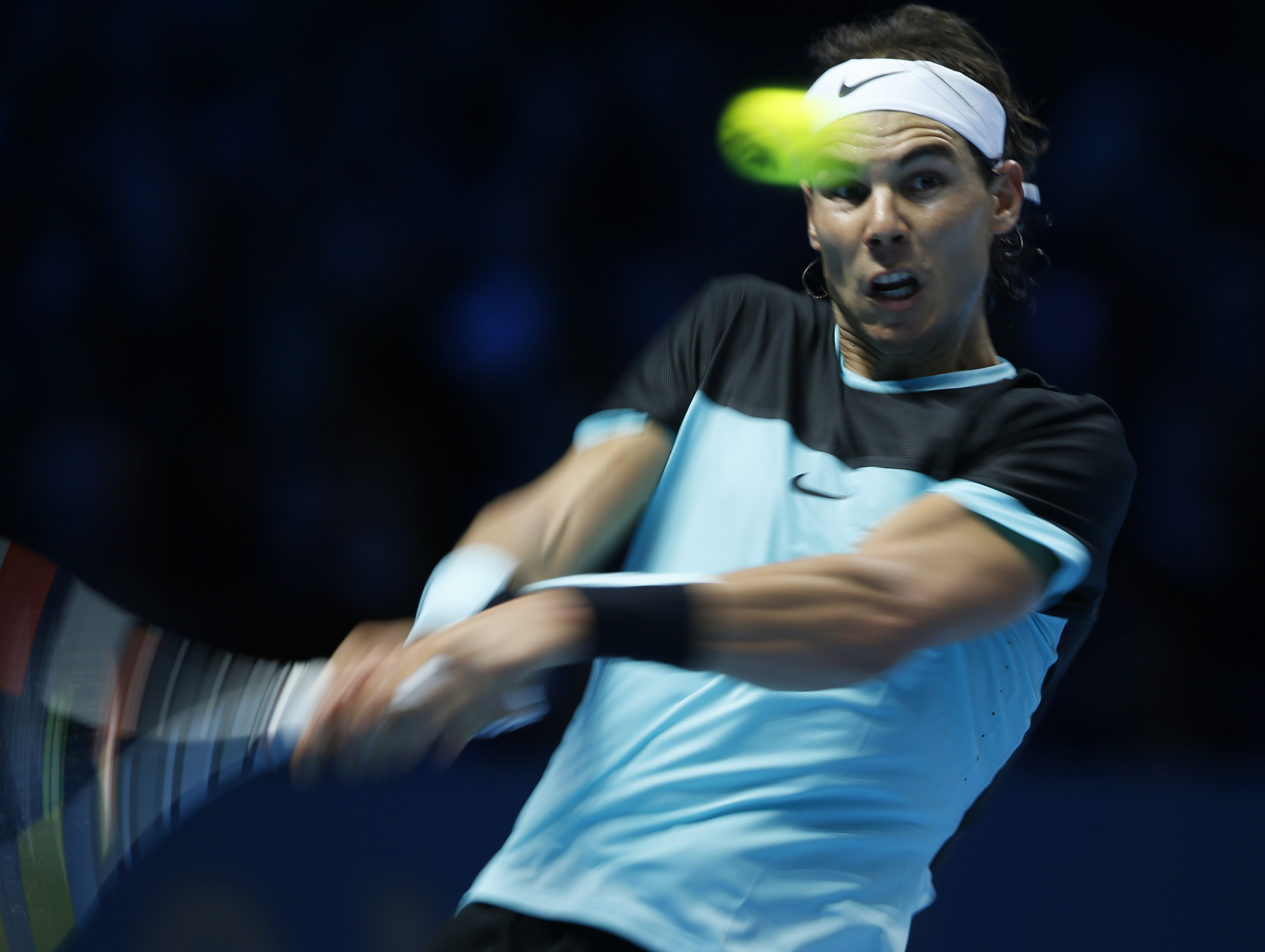 Rafael Nadal of Spain hits a return to David Ferrer of Spain during their singles tennis match at the ATP World Tour Finals at the O2 Arena in London, Friday, Nov. 20, 2015. (AP Photo/Alastair Grant)