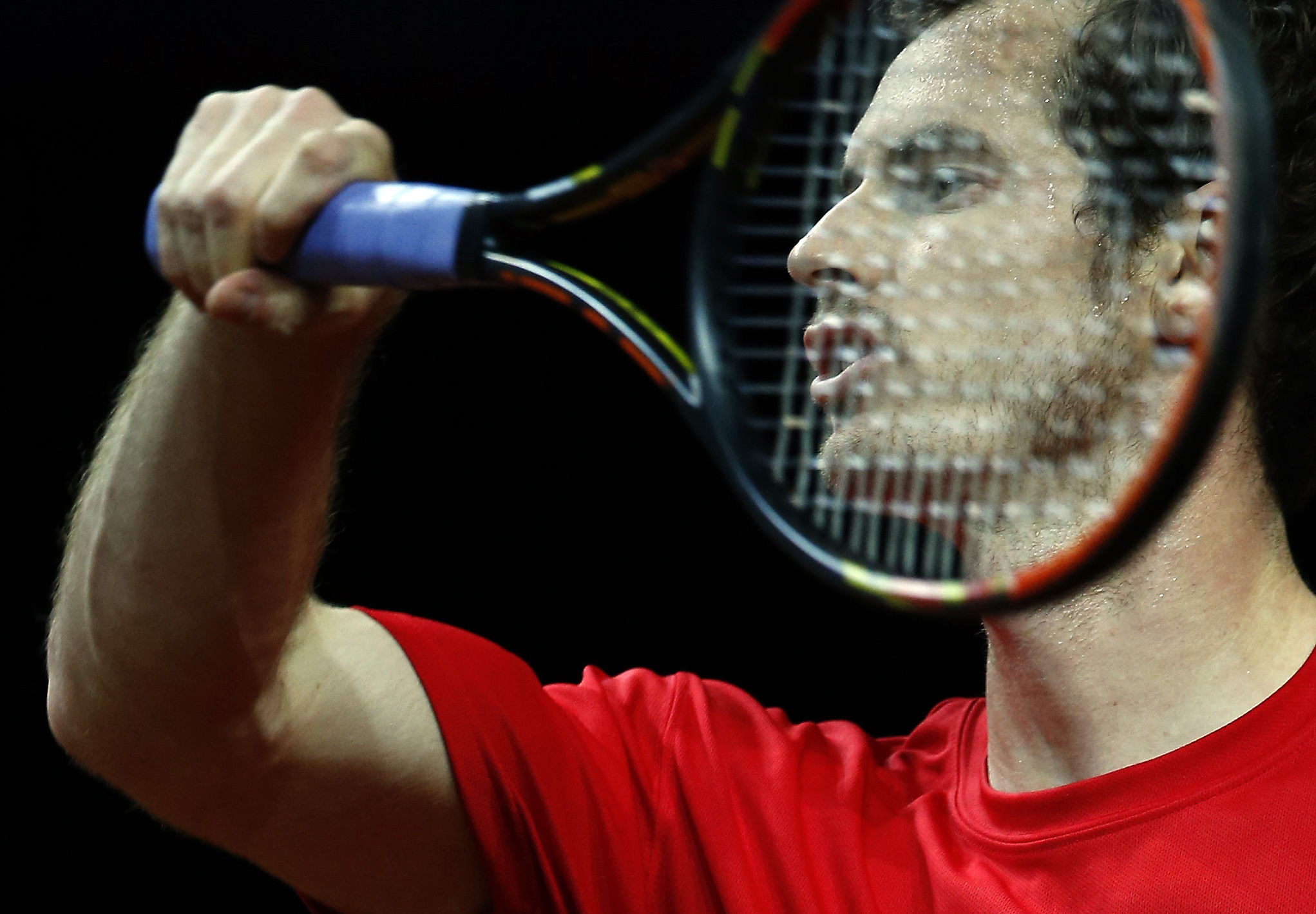 Britain's Andy Murray hits a return during a practice session ahead of the Davis Cup Final tennis match between Belgium and Britain, in Ghent, Belgium, Tuesday, Nov. 24, 2015. The final starts Friday and runs till Sunday. (AP Photo/Alastair Grant)
