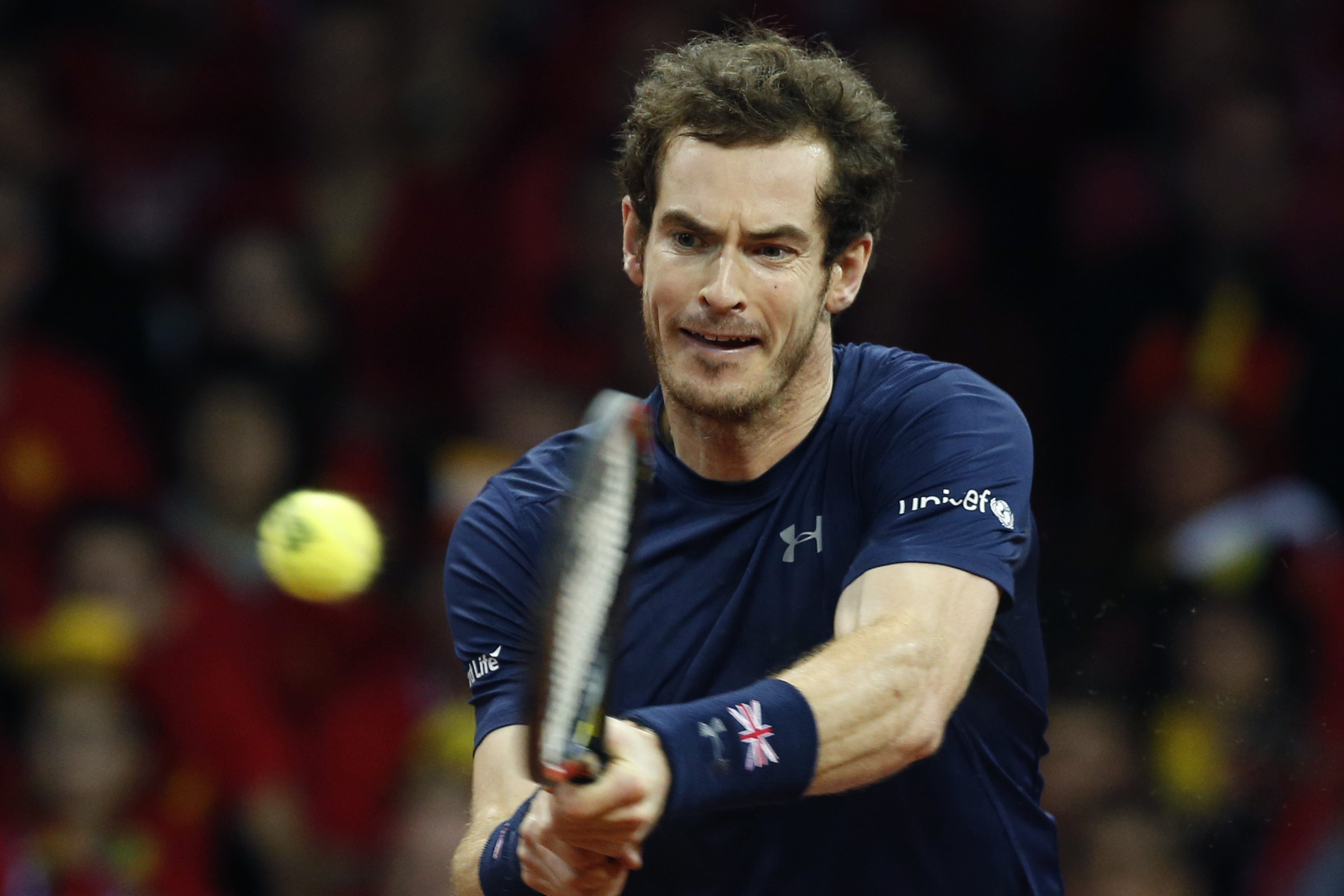 Britain's Andy Murray returns against Belgium's David Goffin during their singles Davis Cup final tennis match at the Flanders Expo in Ghent, Belgium, Sunday, Nov. 29, 2015. (AP Photo/Alastair Grant)