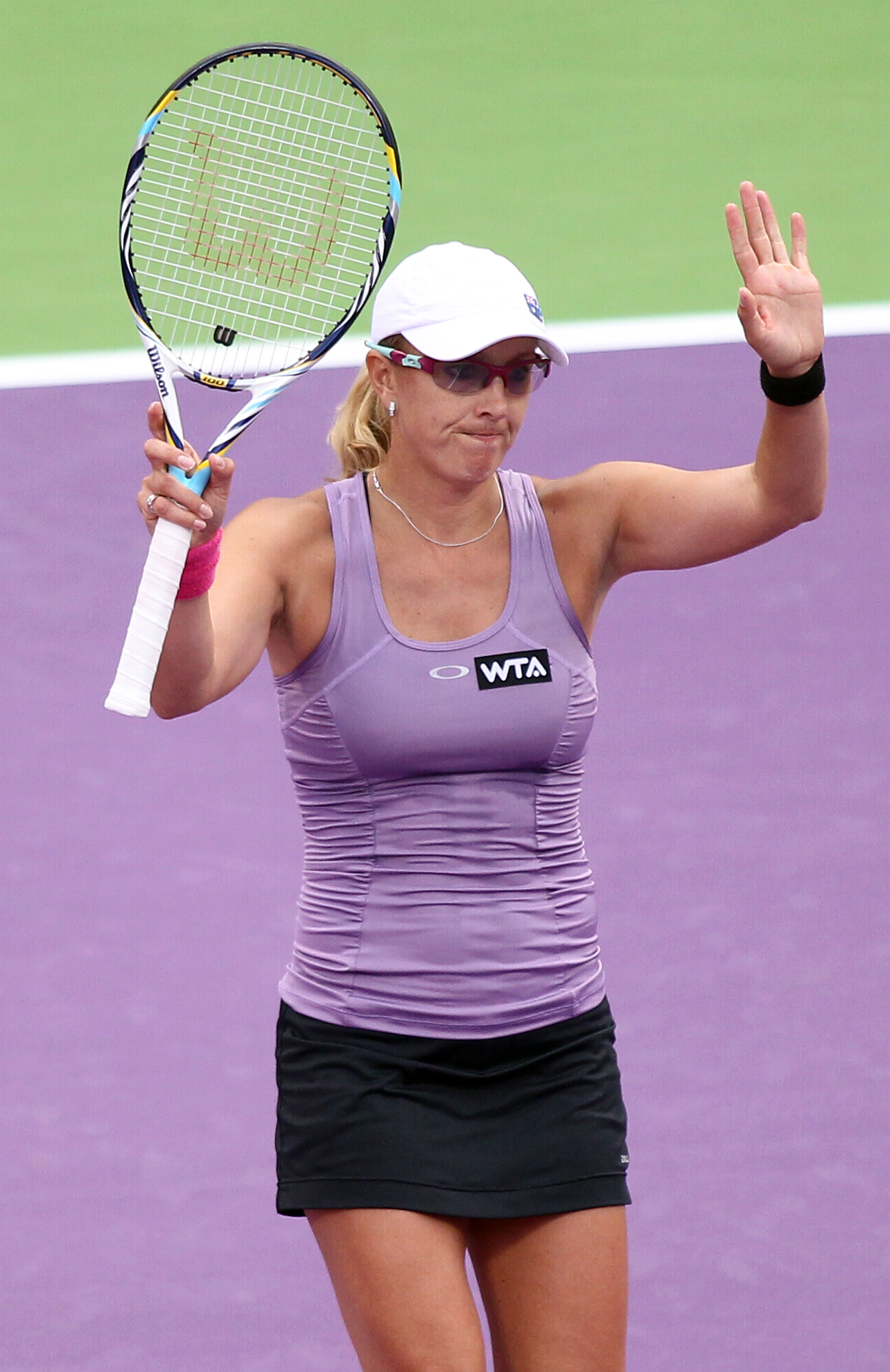 Anastasia Rodionova of Australia reacts after losing a point against Jie Zheng of China during the first day of the WTA Qatar Ladies Open in Doha, Qatar, Monday, Feb. 11, 2013. (AP Photo/Osama Faisal)