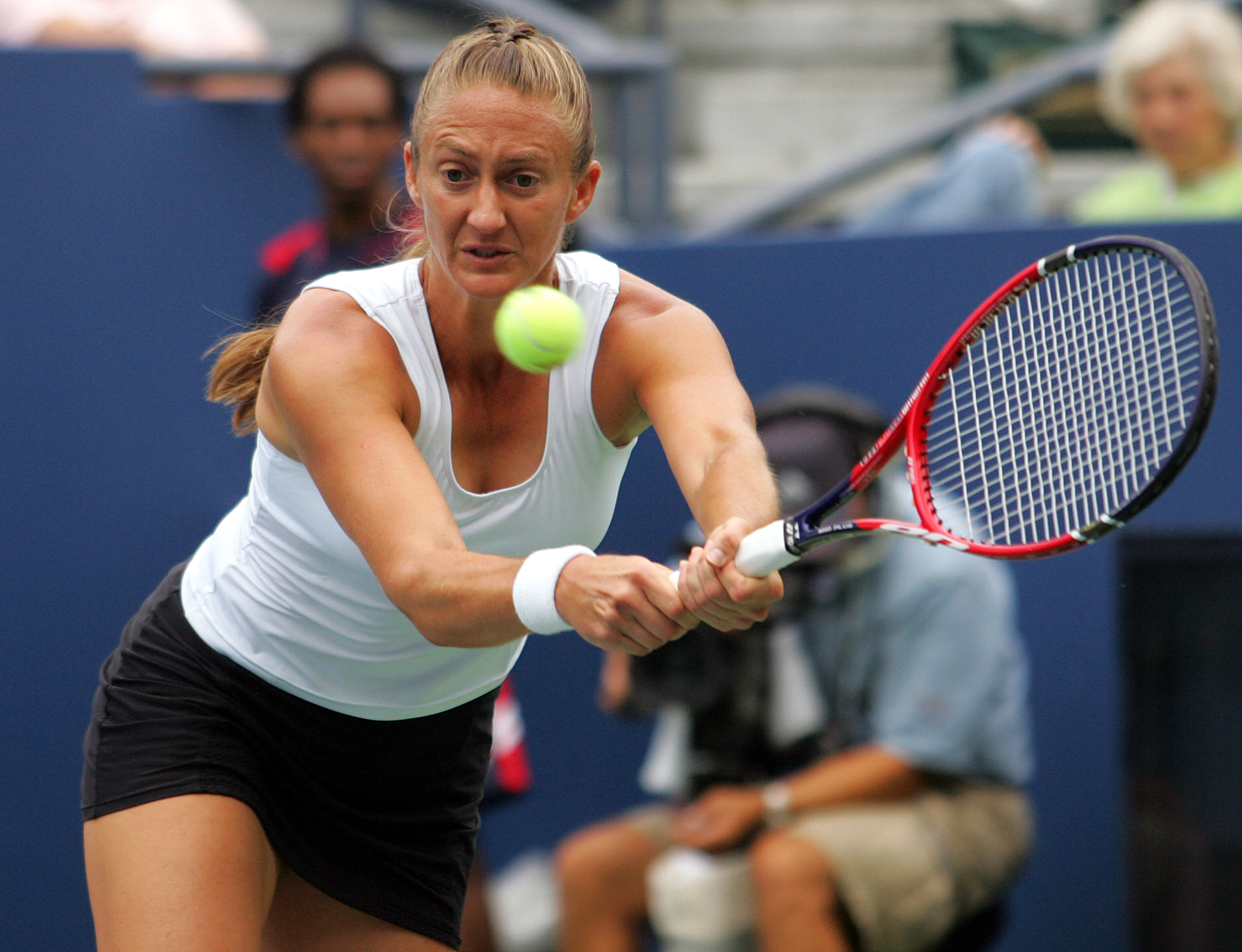 Mary Pierce of France returns a shot to Elena Vesnina of Russia at the US Open tennis tournament in New York, Wednesday, Aug. 30, 2006. (AP Photo/Ed Betz)