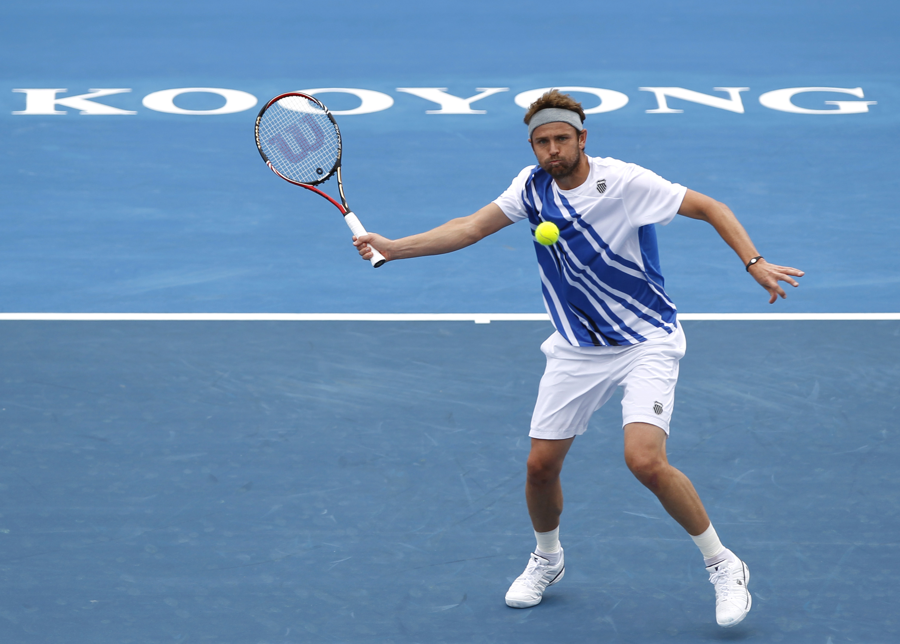 US tennis player Mardy Fish returns to  Bernard Tomic of Australia  in the final of the Kooyong Classic in Melbourne, Australia, Saturday, Jan. 14, 2012. (AP Photo/Shuji Kajiyama)