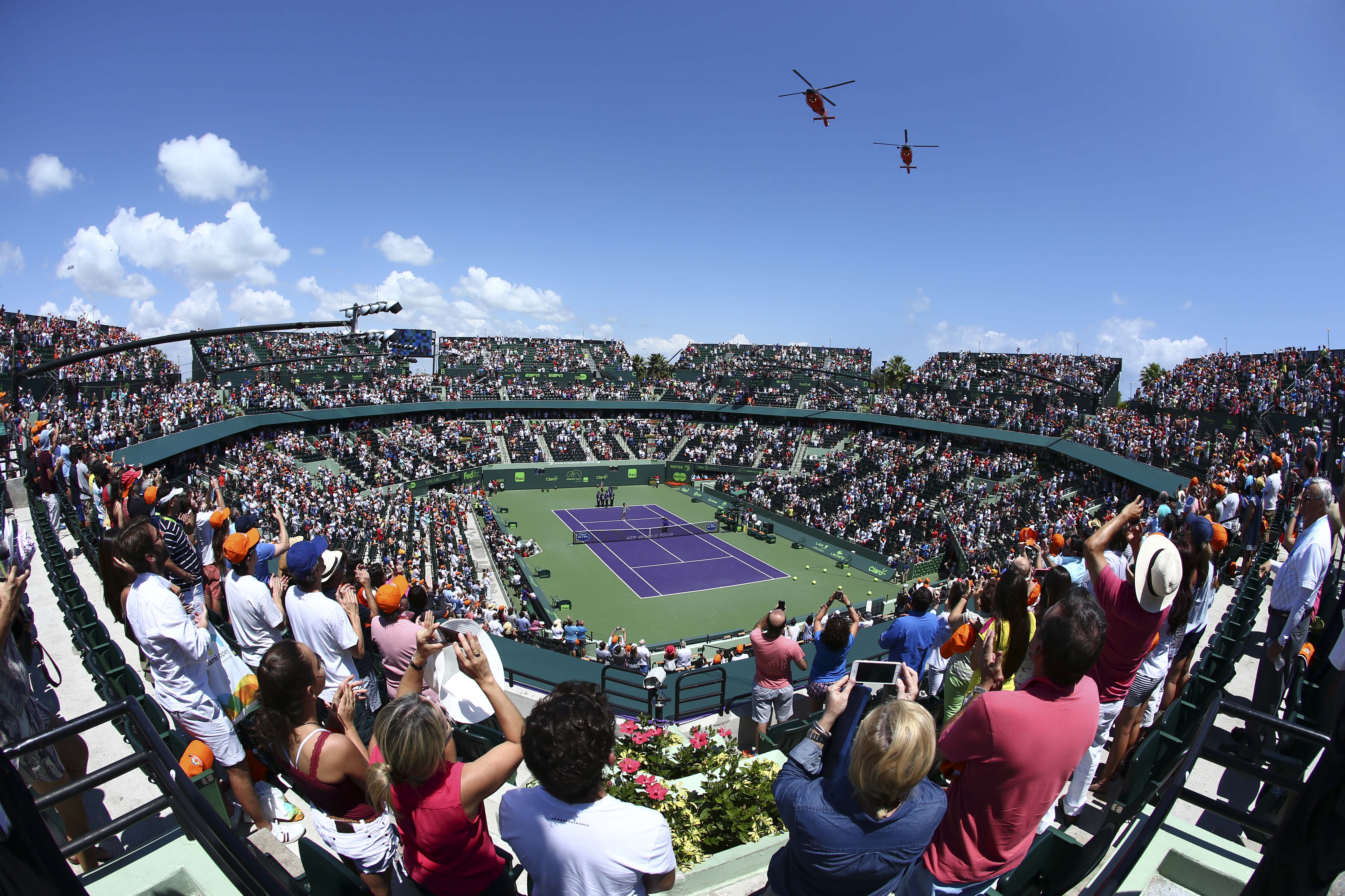 U.S. Coast Guard helicopters fly over the Stadium Court before a match between Novak Djokovic, of Serbia, and Andy Murray, of Great Britain, at the men's final match of the Miami Open tennis tournament Sunday, April 5, 2015, in Key Biscayne, Fla. (AP Phot