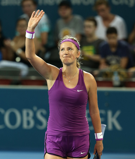 Victoria Azarenka of Belarus celebrates after winning her match against Elena Vesnina of Russia 6-2, 6-0, at the Brisbane International tennis tournament in Brisbane, Australia, Monday, Jan. 4, 2016. (AP Photo/Tertius Pickard)