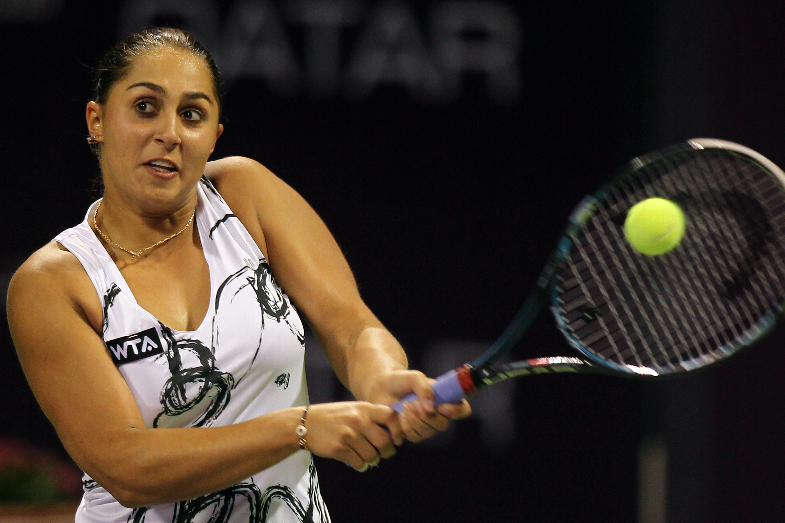 Tamira Paszek of Austria returns the ball during her match against Ana Ivanovic of Serbia on the first day of the WTA Qatar Ladies Open in Doha, Qatar, Monday, Feb. 11, 2013. (AP Photo/Osama Faisal)