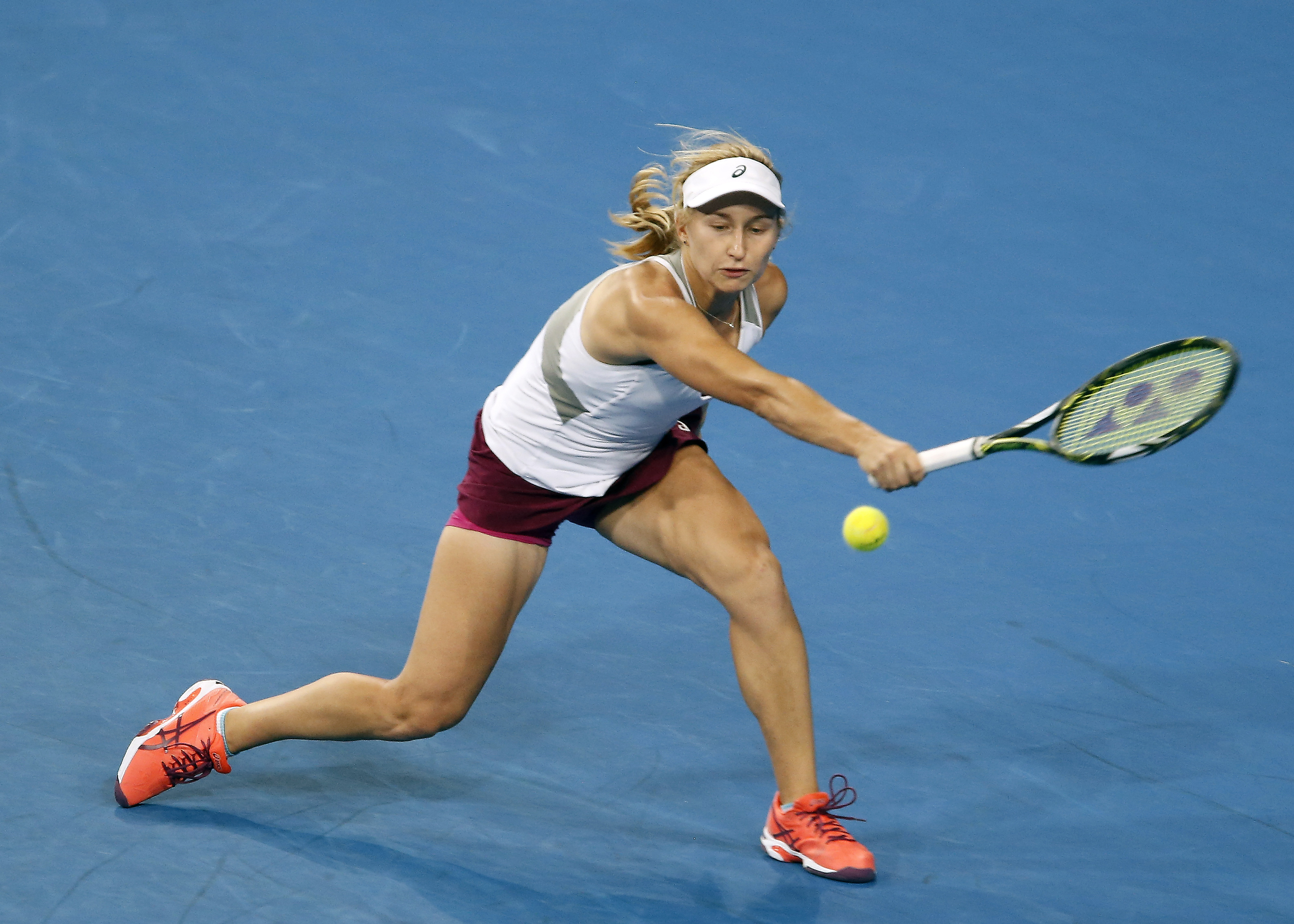 Daria Gavrilova of Australia plays a backhand shot against Elina Svitolina of Ukraine during the women's singles final at the Hopman Cup tennis tournament in Perth, Australia, Saturday, Jan. 9, 2016. (AP Photo/Theron Kirkman)