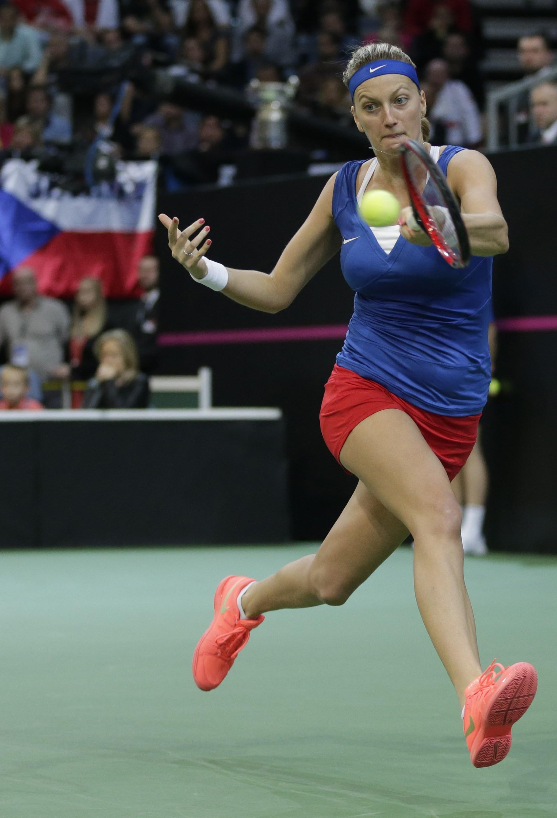 Czech Republic's Petra Kvitova returns a ball to Russia's Maria Sharapova during their Fed Cup tennis final match between Czech Republic and Russia in Prague, Czech Republic, Sunday, Nov. 15, 2015. (AP Photo/Petr David Josek)