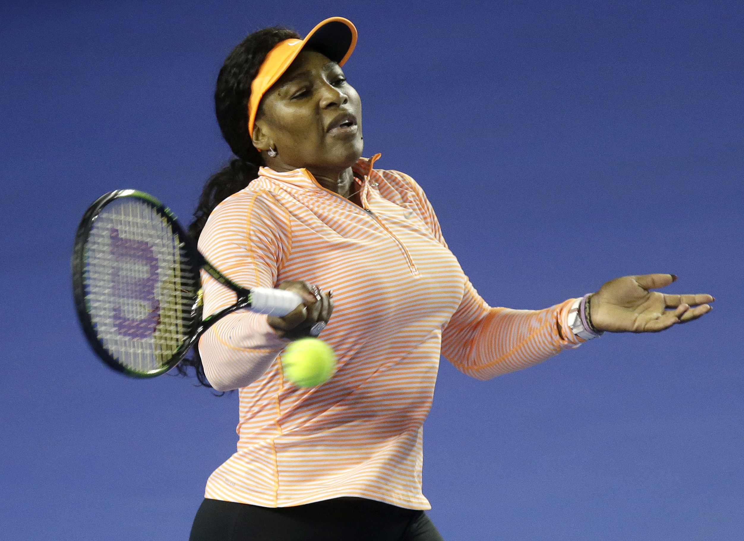 Serena Williams of the US hits a forehand return during a practice session on Rod Laver Arena ahead of the Australian Open tennis championships in Melbourne, Australia, Thursday, Jan. 14, 2016.(AP Photo/Mark Baker)