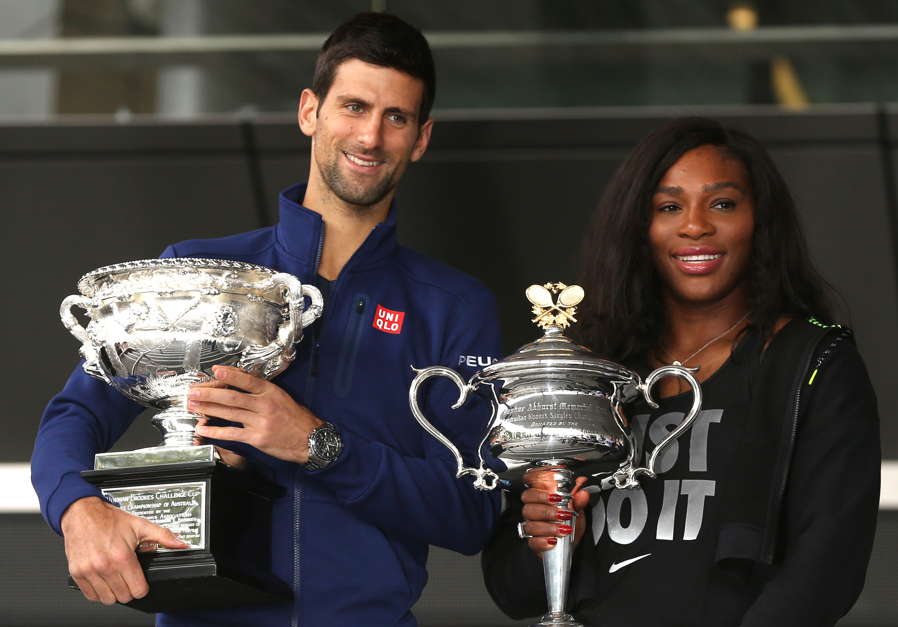 Defending champions Serena Williams of the US and Serbia's Novak Djokovic pose for a photo with their trophies as they arrive for the official draw at the Australian Open tennis championships in Melbourne, Australia, Friday, Jan. 15, 2016. (AP Photo/Mark