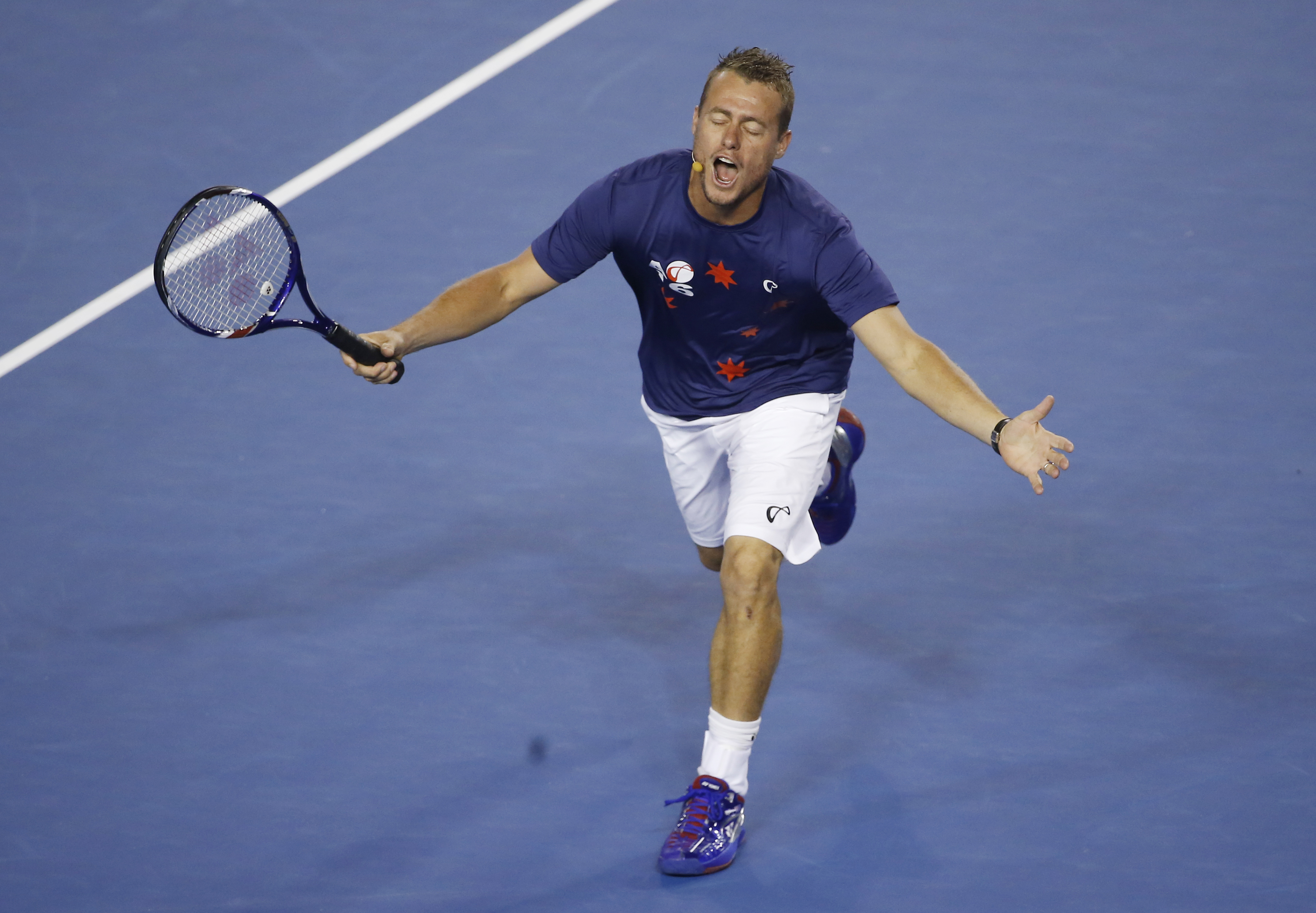 Australia's Lleyton Hewitt reacts during Kids Tennis Day, an exhibition event on Rod Laver Arena ahead of the Australian Open tennis championships in Melbourne, Australia, Saturday, Jan. 16, 2016.(AP Photo/Vincent Thian)